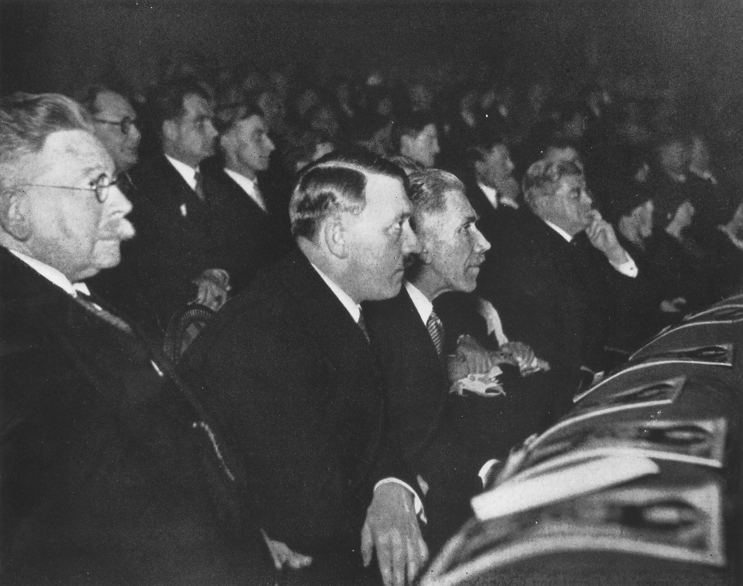 Adolf Hitler attends a session of the Reichstag on the first day of business for his new cabinet.  Pictured in the front row from left to right are: Alfred Hugenberg, Adolf Hitler and Franz von Papen.