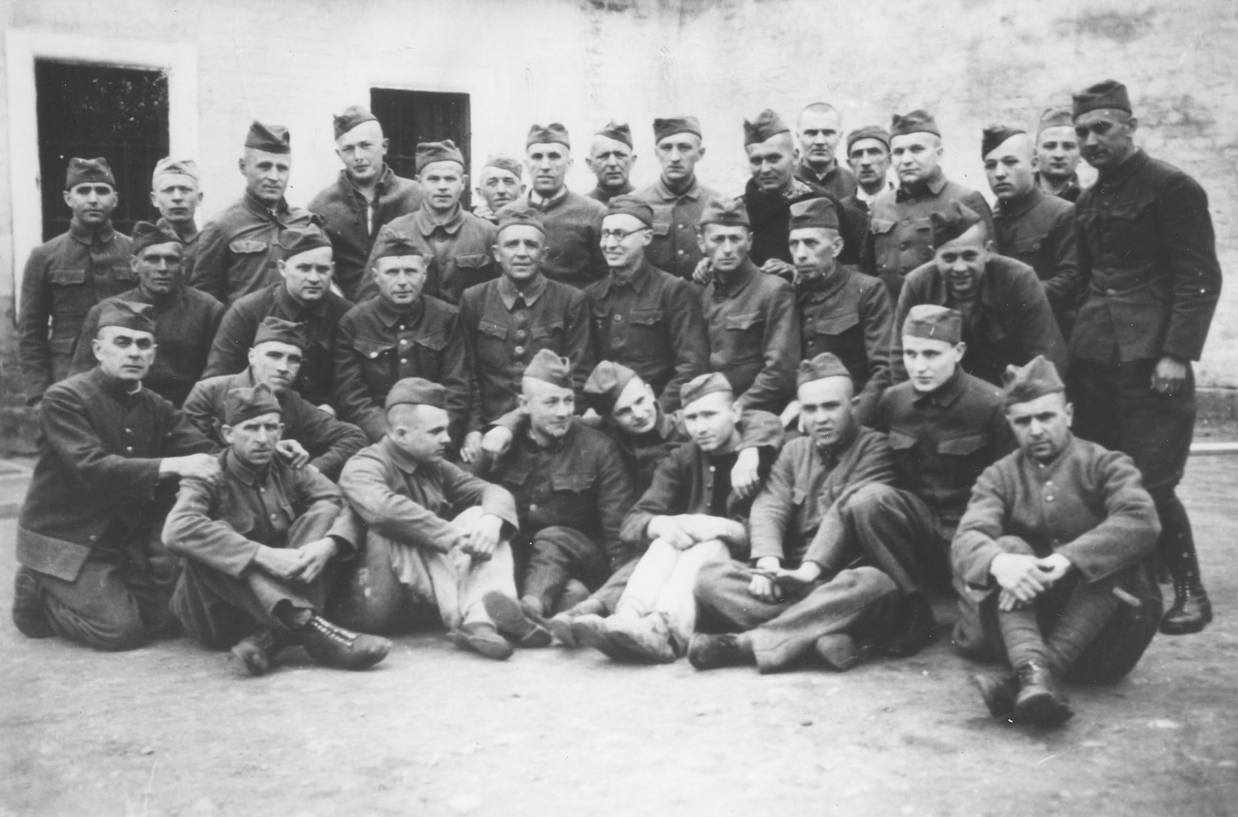 Group portrait of Czech political prisoners who shared a cell bloc in Theresienstadt.  Oskar Bartolsic is pictured in the front row, second from the left.