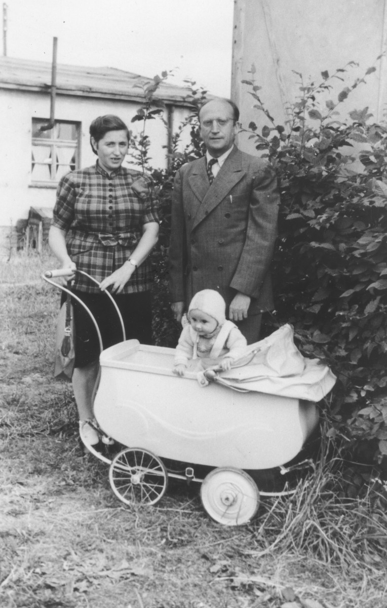 Max and Roza Goldfarb pose outside with their toddler at the Ziegenhain displaced persons camp.