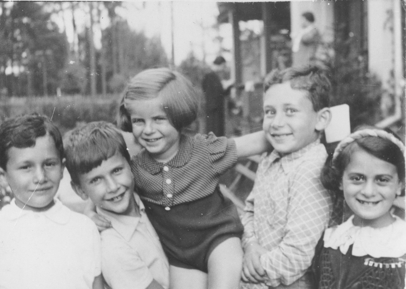 Five Jewish children play together in the resort town of Krynica.