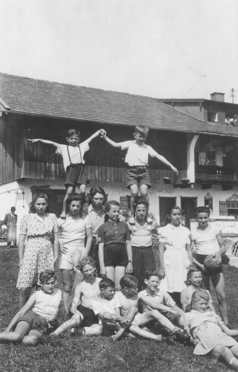 A group of children pose outdoors at a school for Jewish DPs in Munich.   Among those pictured is Ellen Griliches (front row, right side, behind the reclining girl) and Fenny Olitzki (second row, second from the left).