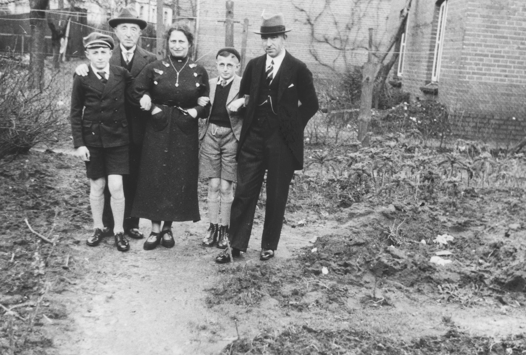 Members of the de Vries family pose outside on the day of their son Robert's bar mitzvah.  Pictured from left to right are: Moritz, Benjamin, Ella, Robert and Paul de Vries. Robert and Paul survived in the Westerbork transit camp.  Benjamin, Ella and Moritz were deported to Auschwitz where they perished.