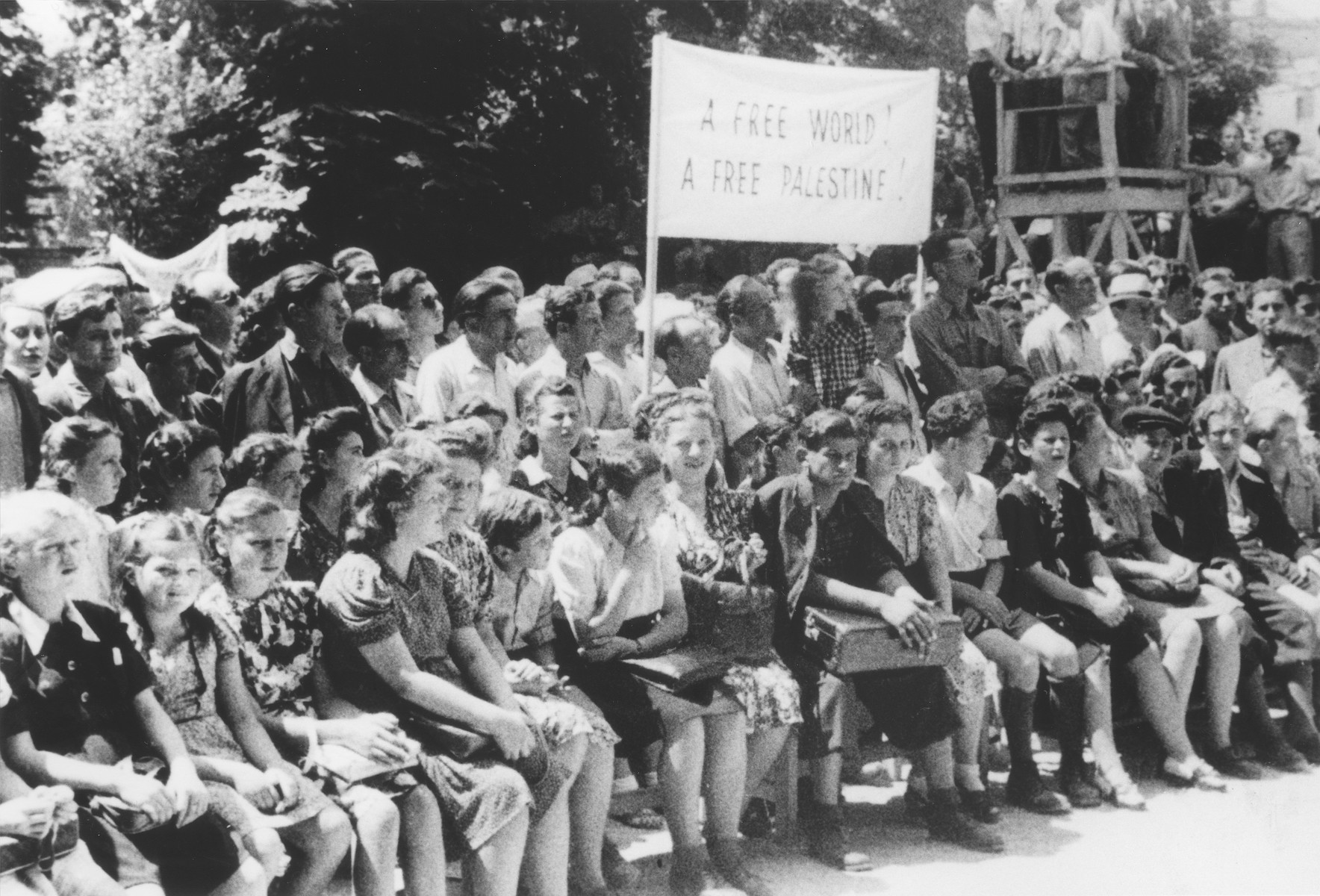 Students at a school for Jewish DPs in Munich, attend a demonstration calling for free immigration to Palestine.  Among those pictured is Ellen Griliches (front row, third from the left).