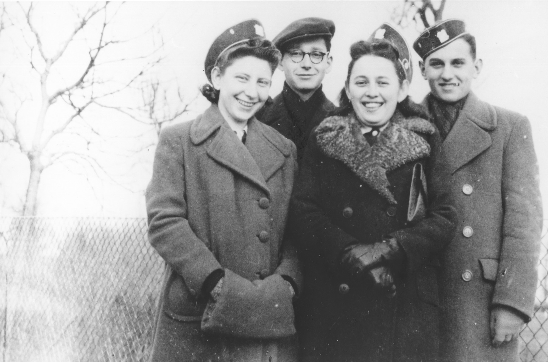 Four students from the Hebrew gymnasium in Mukachevo pose wearing their school caps.  Pictured from left to right are: Miriam Katz, Eva Braun and Bela Grunbaum.