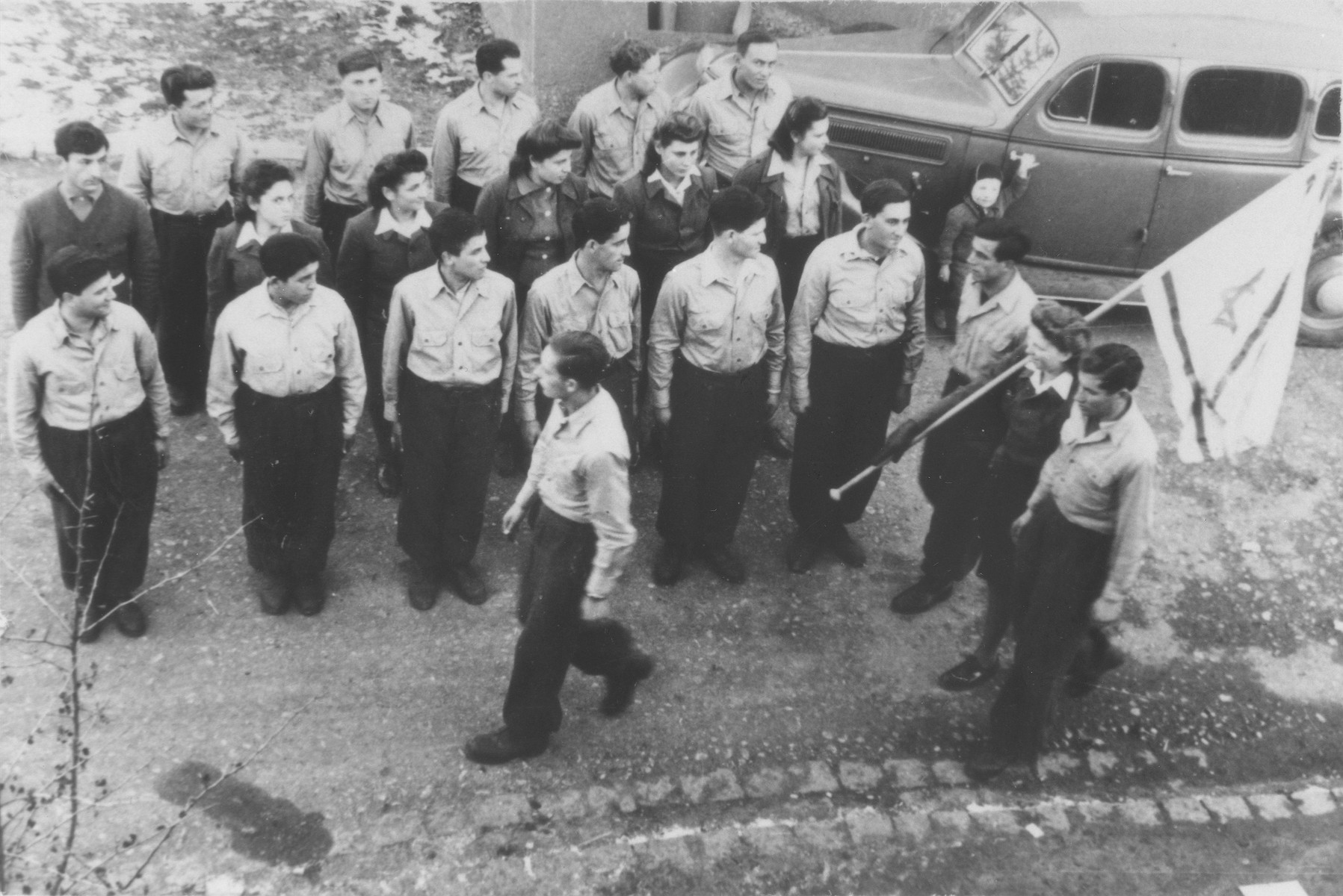 Members of the hachshara [Zionist collective] Kibbutz Hathiya stand in formation during a procession at the Foehrenwald displaced persons camp.