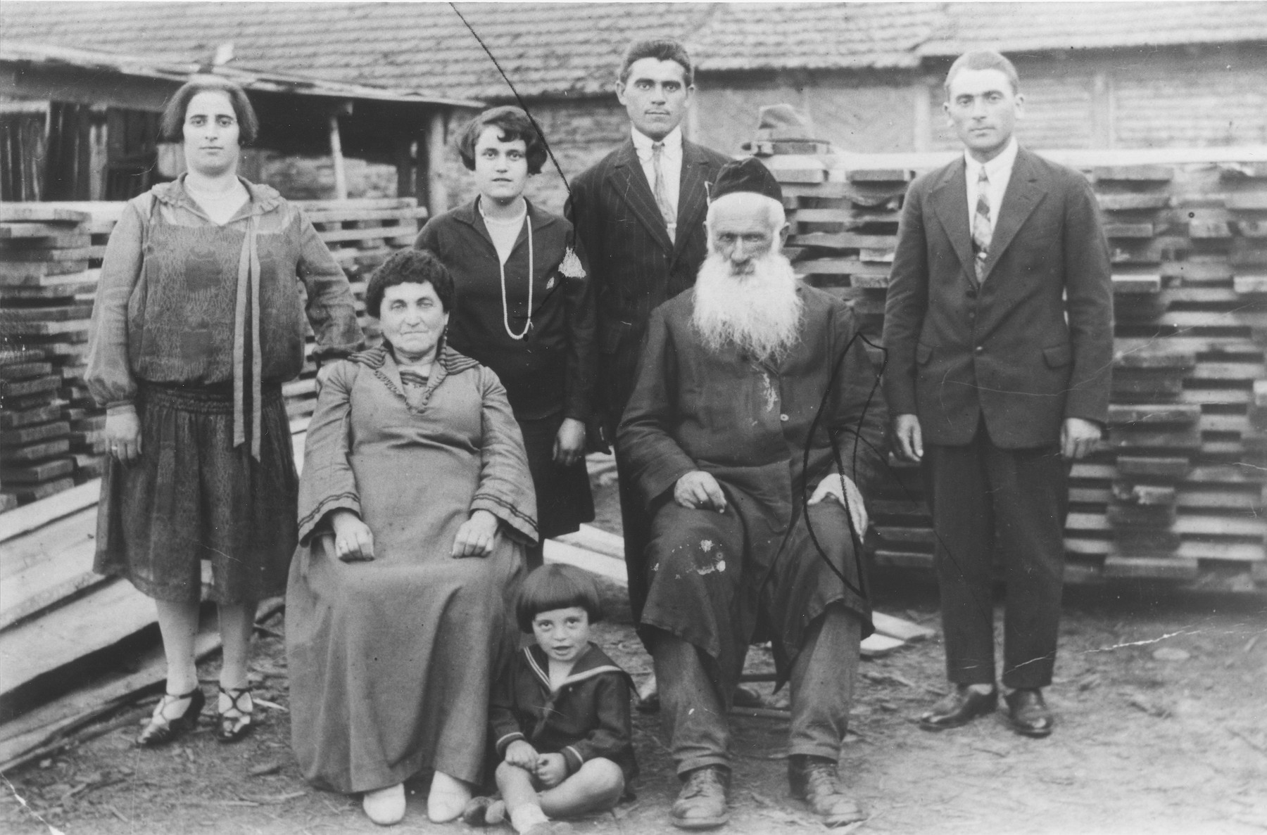 Members of the Rakowski and Banach families pose in their lumberyard in Kazimierza Wielka.  Pictured from left to right are: Frania, Ita, Jozef and Moshe Dawid Rakowski, and Jozef Banach.