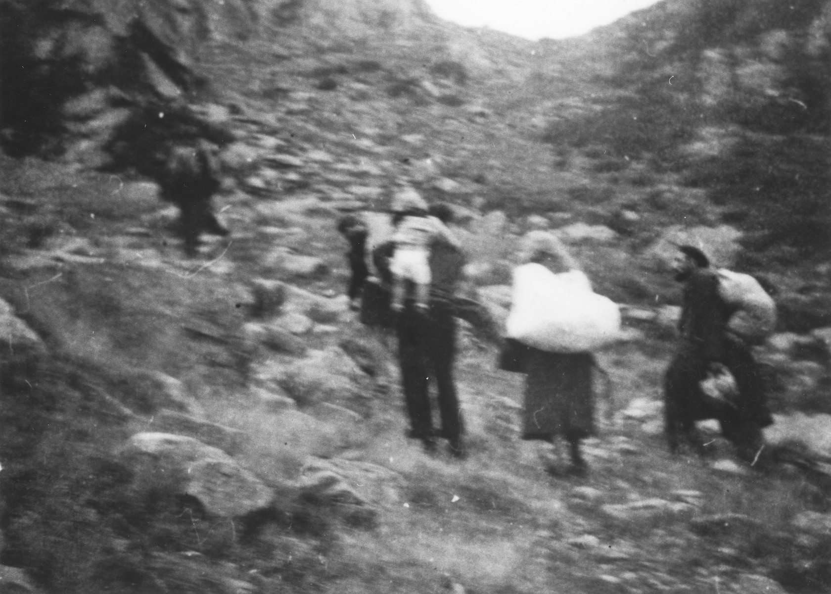 Jewish refugees escape over the Alps to Italy from the Italian-occupied zone in France following the signing of the Italian armistice.