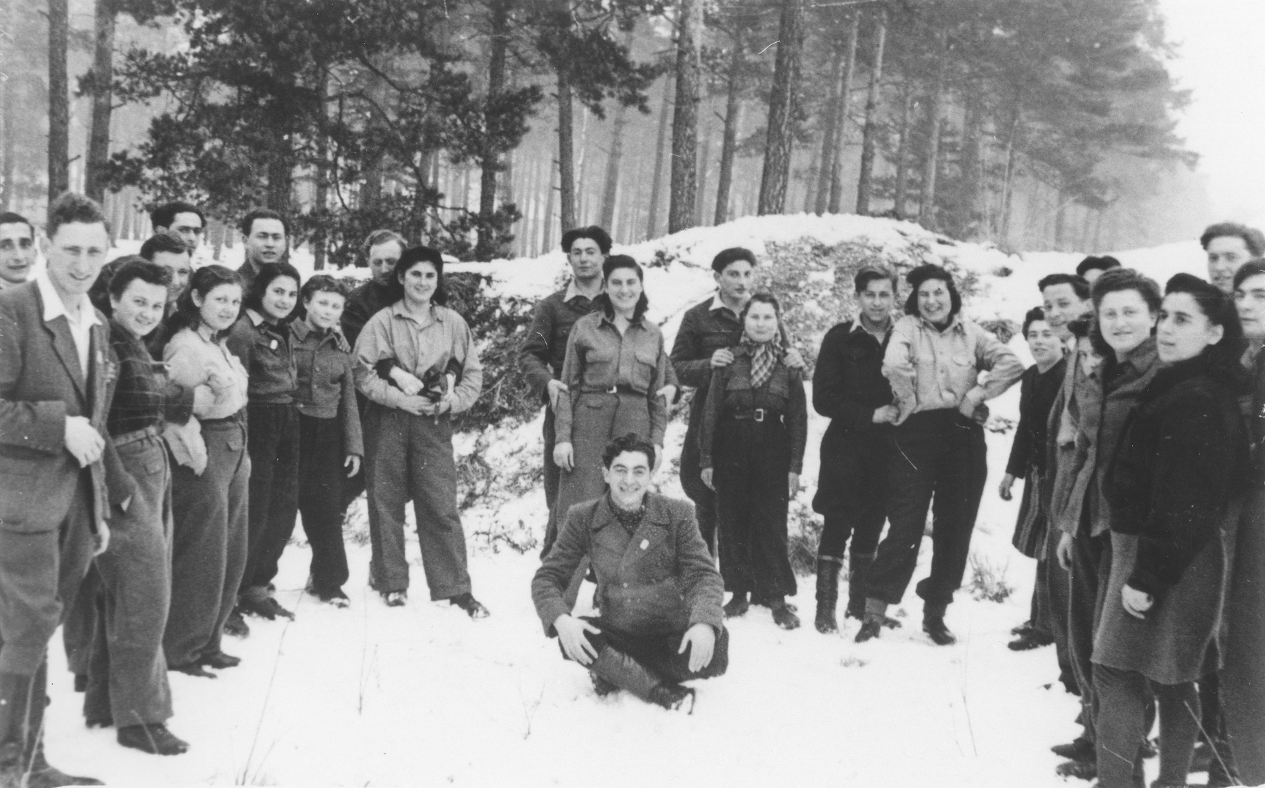 Shmuel Rakowski (seated) poses with a group of Jewish DPs who he escorted out of Poland on a Bricha route.