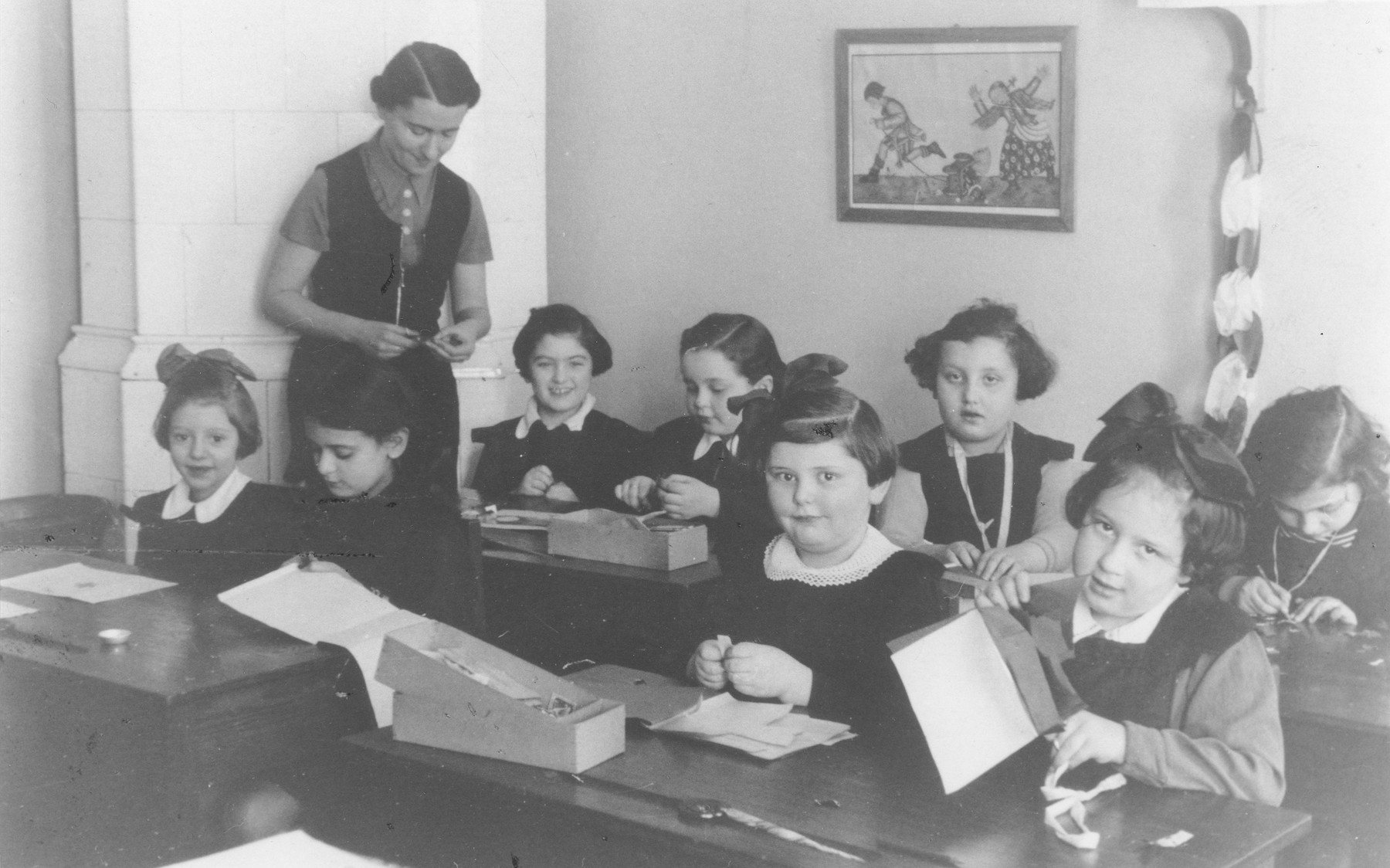 Pupils in the second grade work in their classroom at the Kalecka Jewish elementary school in Warsaw.  Among those pictured is Basia Berkowicz (front row, second from the left).