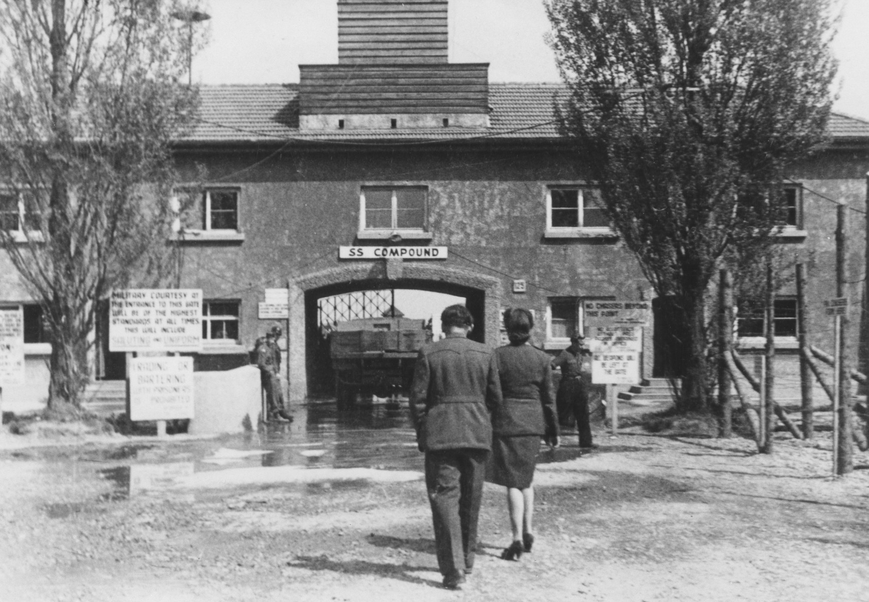 Red Cross worker Adeline Bustelman visits the former Dachau SS compound approximately one year after its liberation.