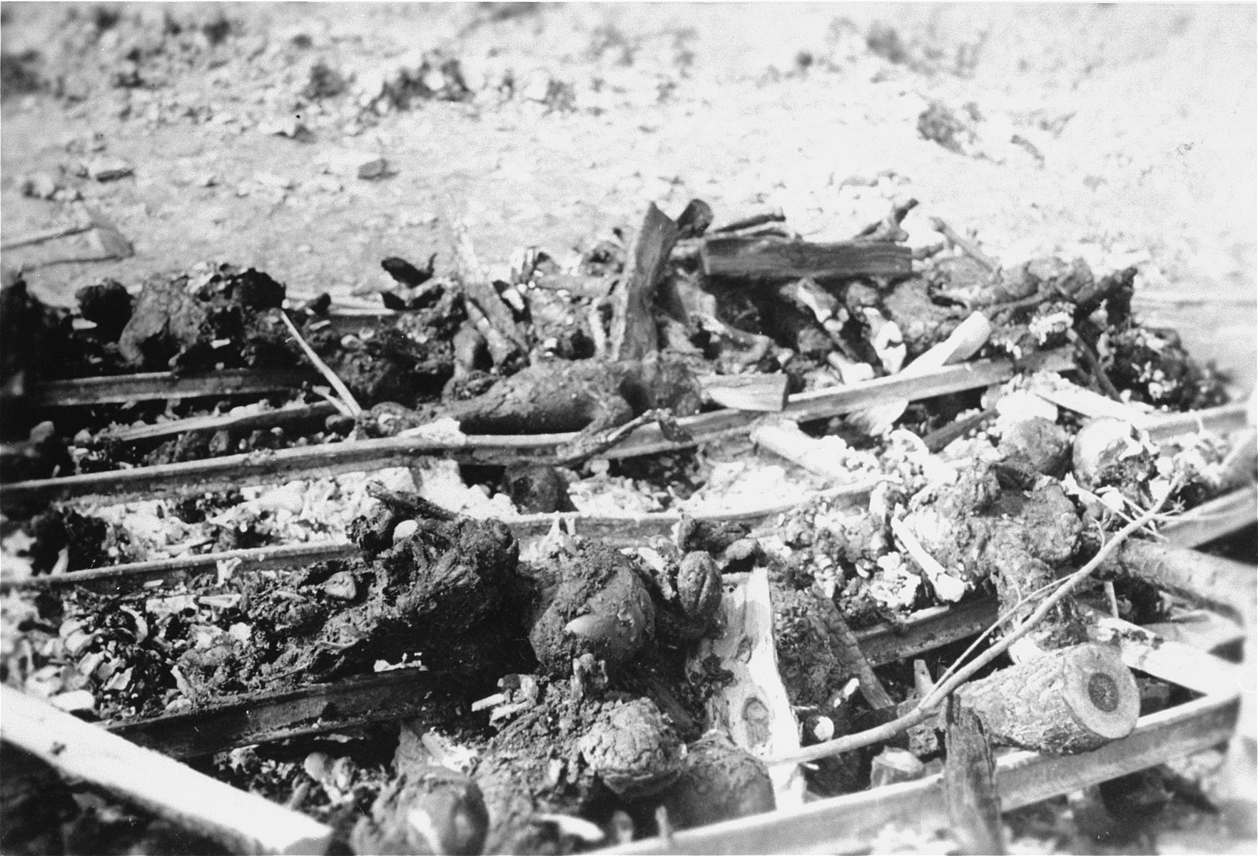The charred remains of corpses burned by the SS prior to the evacuation of the Ohrdruf concentration camp.