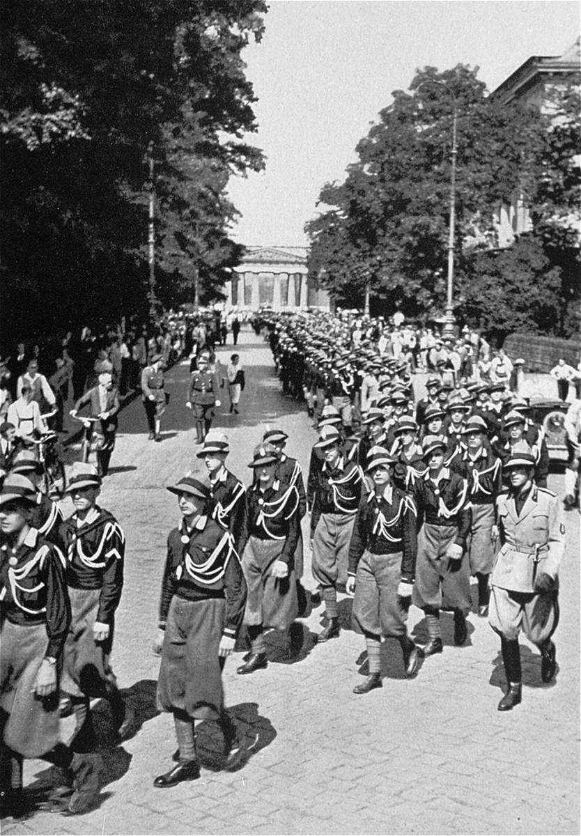 "Italian fascist youth group members, or ""Avantguardia,"" marching through Munich on their way to visit Adolf Hitler."