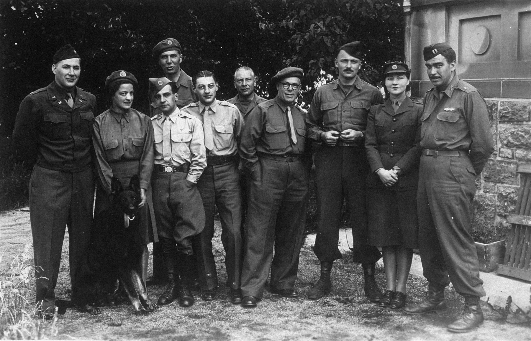 Group portrait of the first UNRRA medical team to arrive at Ohrdruf.    The team was headed by Maureen Honeyball from England, second from right.  Also pictured is Dr. Cecile van Ackere from Brussels, second from left.  The team worked for ten days in late April, 1945, attempting to decontaminate the camp and supply survivors with sufficient nourishment and medical treatment.  Sidney Krasnoff served as a medical officer with the Thirteenth Field Hospital in European Theatre Operations.  After reaching Buchenwald, Krasnoff was assigned to the UNRRA medical team at Ohrdruf.