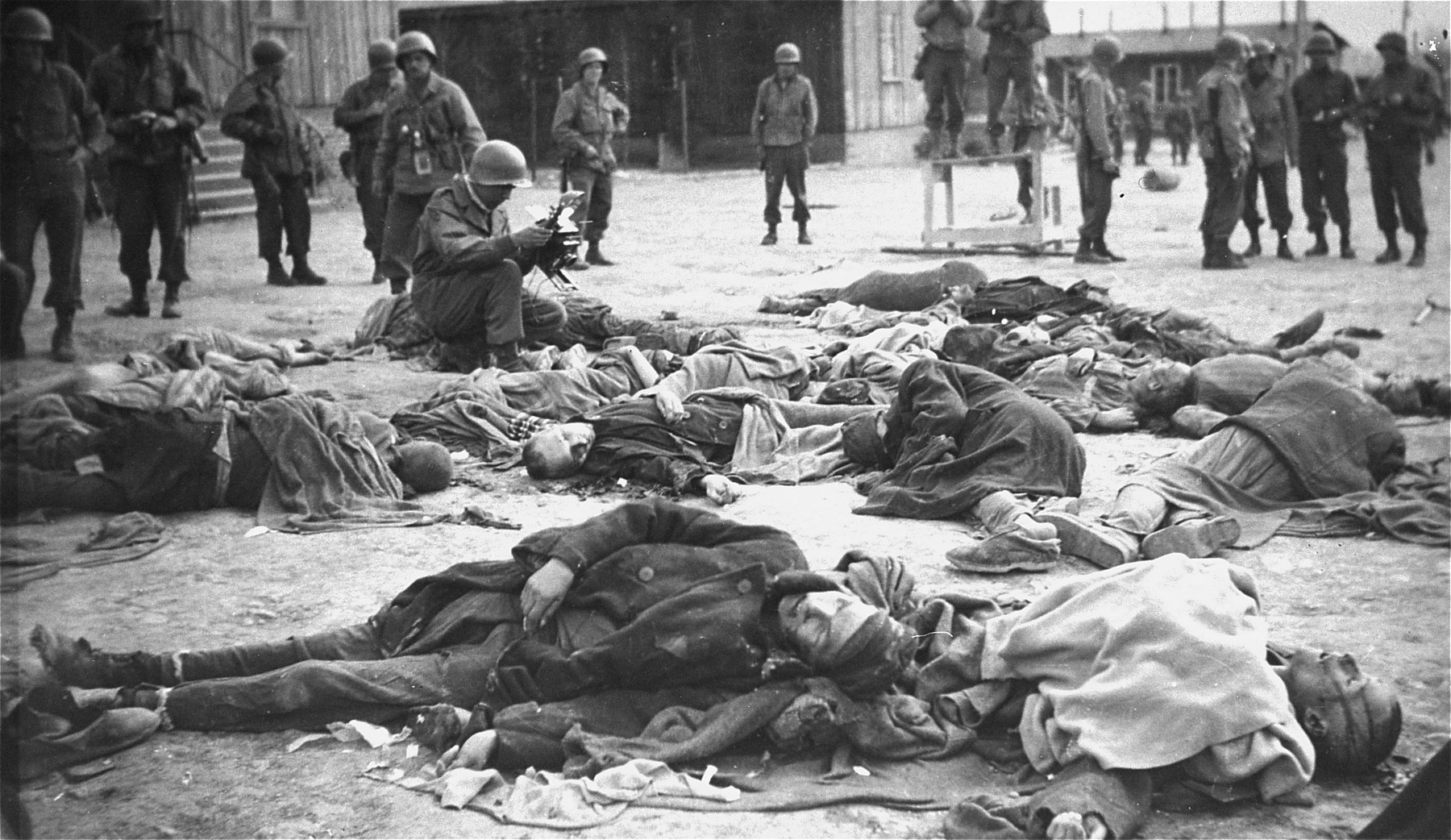 An American soldier views the bodies of prisoners shot by the SS during the evacuation of the Ohrdruf concentration camp.