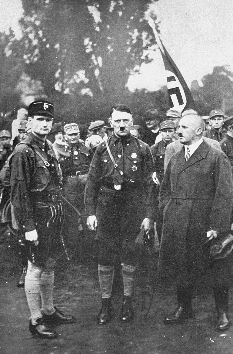 Adolf Hitler, Rudolf Hess (left), and Julius Streicher (right) pose outside at the third Nazi Party Congress in Nuremberg.