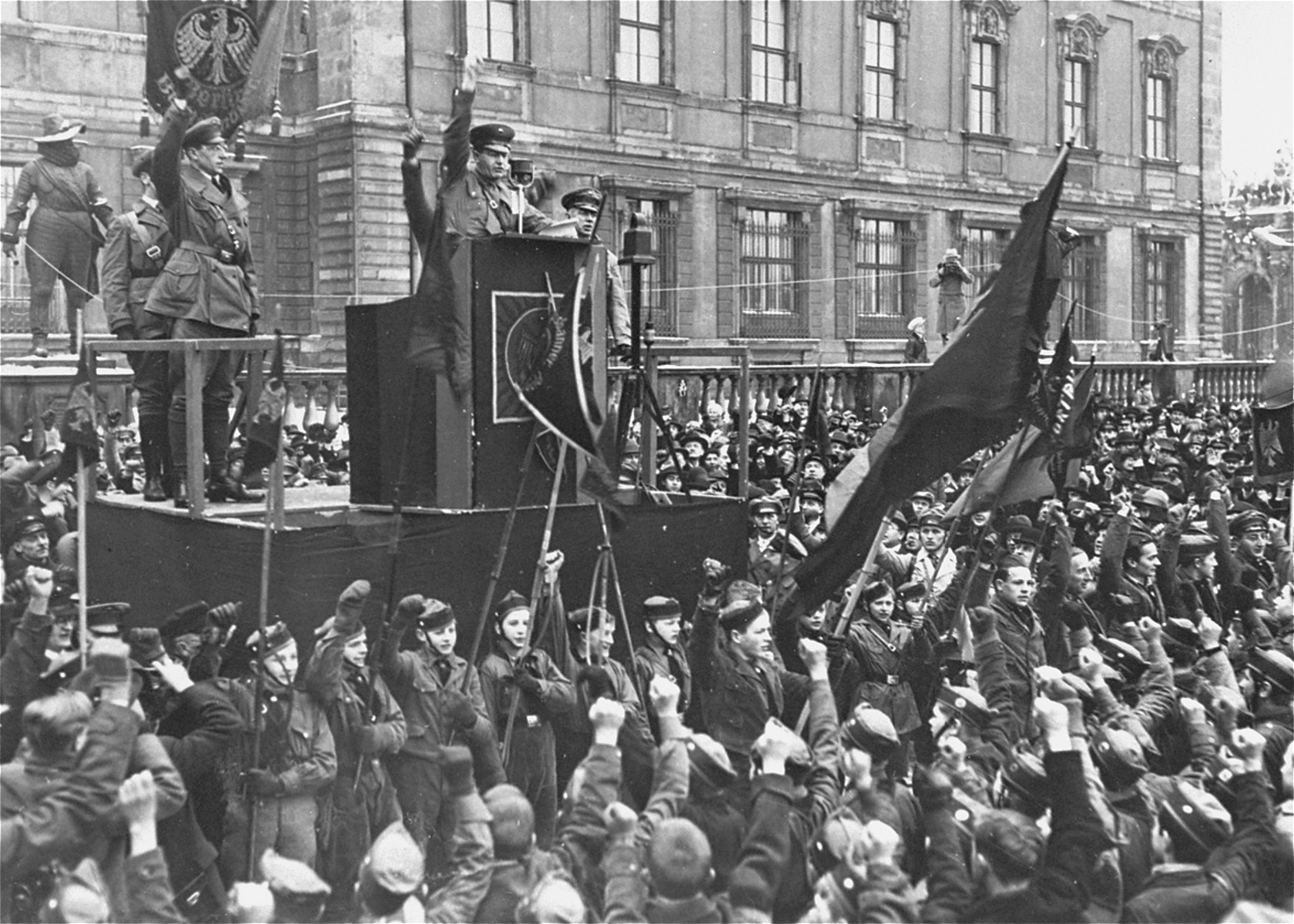 Members of the Reichsbanner cheer during an anti-Nazi speech delivered at a rally in the Berlin Lustgarten.