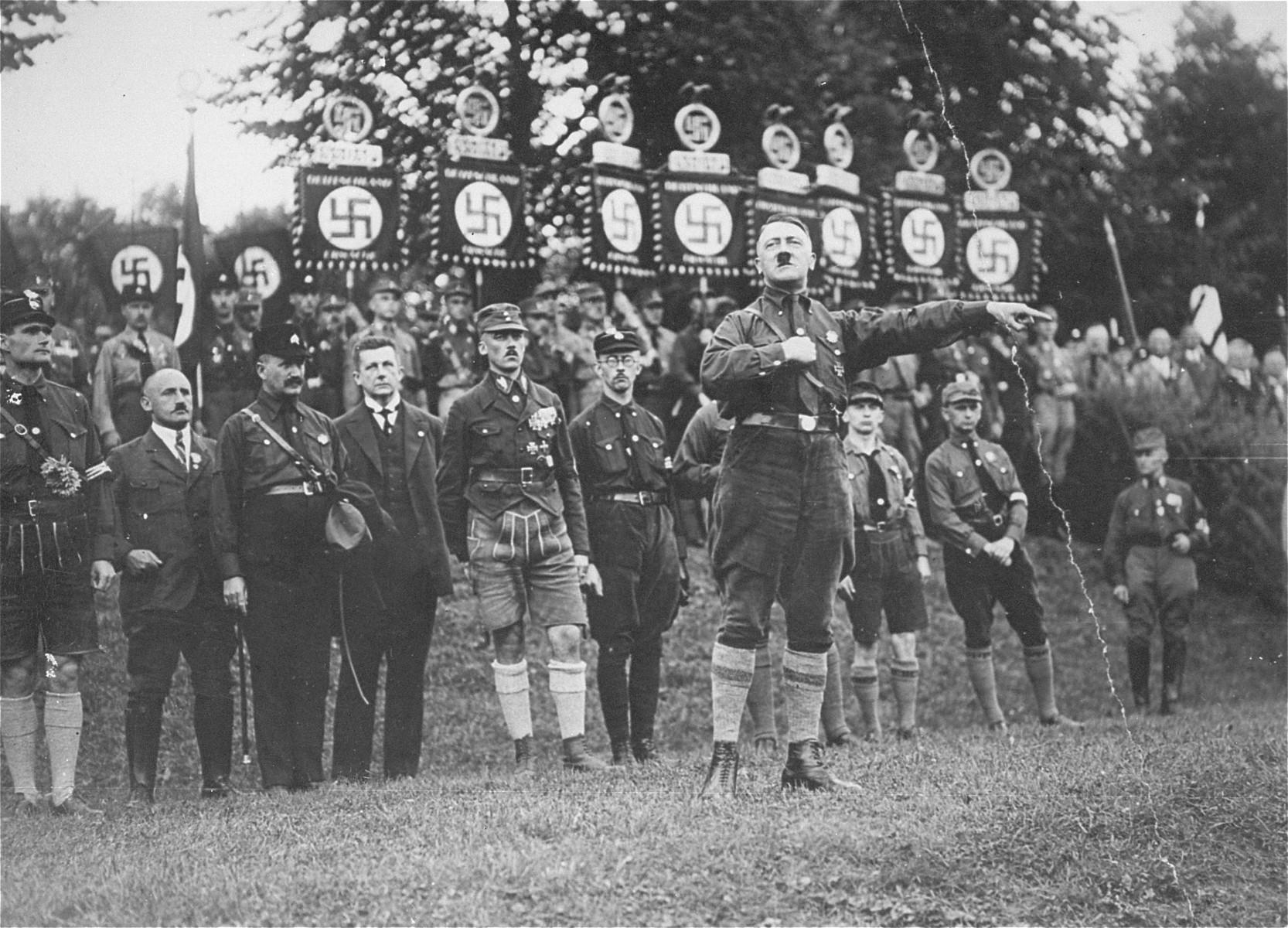 Adolf Hitler gives a speech at the third Nazi Party Congress in Nuremberg.    Behind Hitler are Rudolf Hess, Julius Streicher, and Heinrich Himmler.