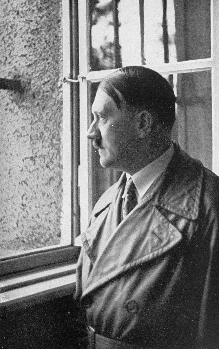Adolf Hitler looks out the window of his former cell at the Landsberg prison during a visit ten years after his release.