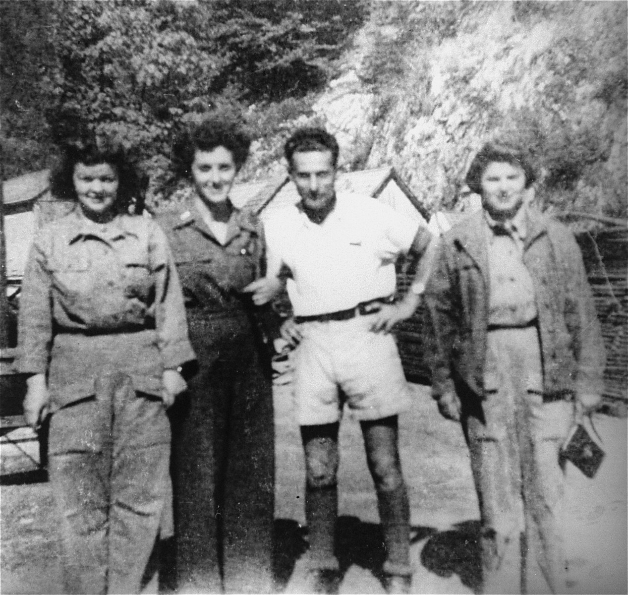 Nurses from the U.S. Army 30th Field Hospital with Adolf Burger, a survivor, in the Ebensee concentration camp.  Pictured from left to right are Lt. Mary Beggs, Lt. Julia Davis, and Lt. Ada Timmer.