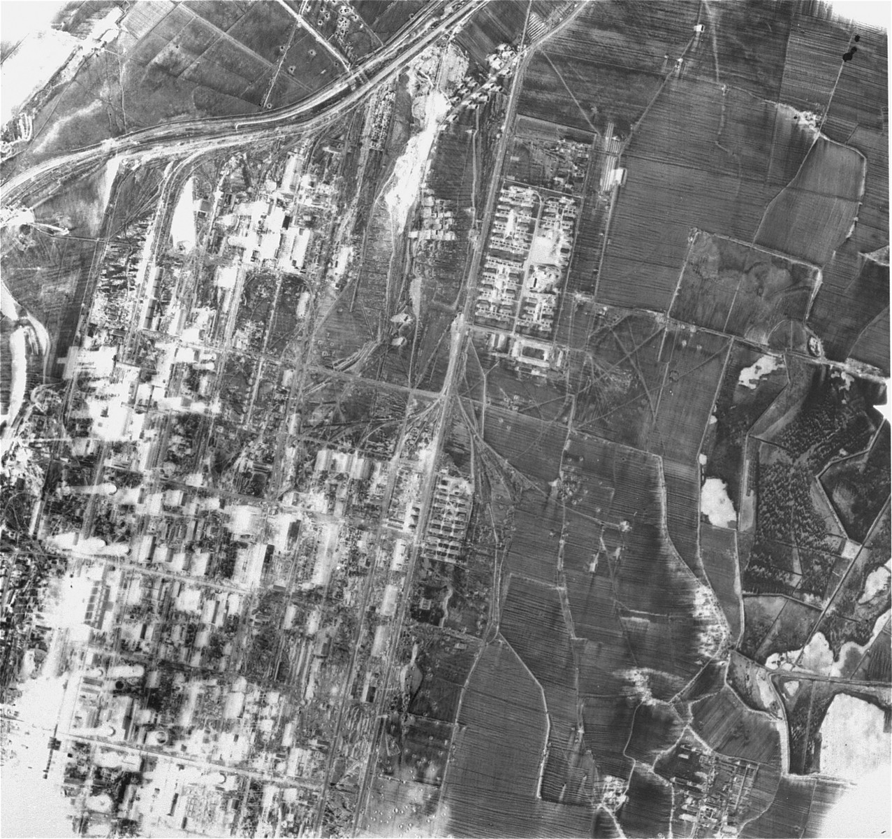 An aerial reconnaissance photograph showing Auschwitz.  [Oversized photograph]  On the left is part of Buna.  On the upper right is the Nonowitz camp.