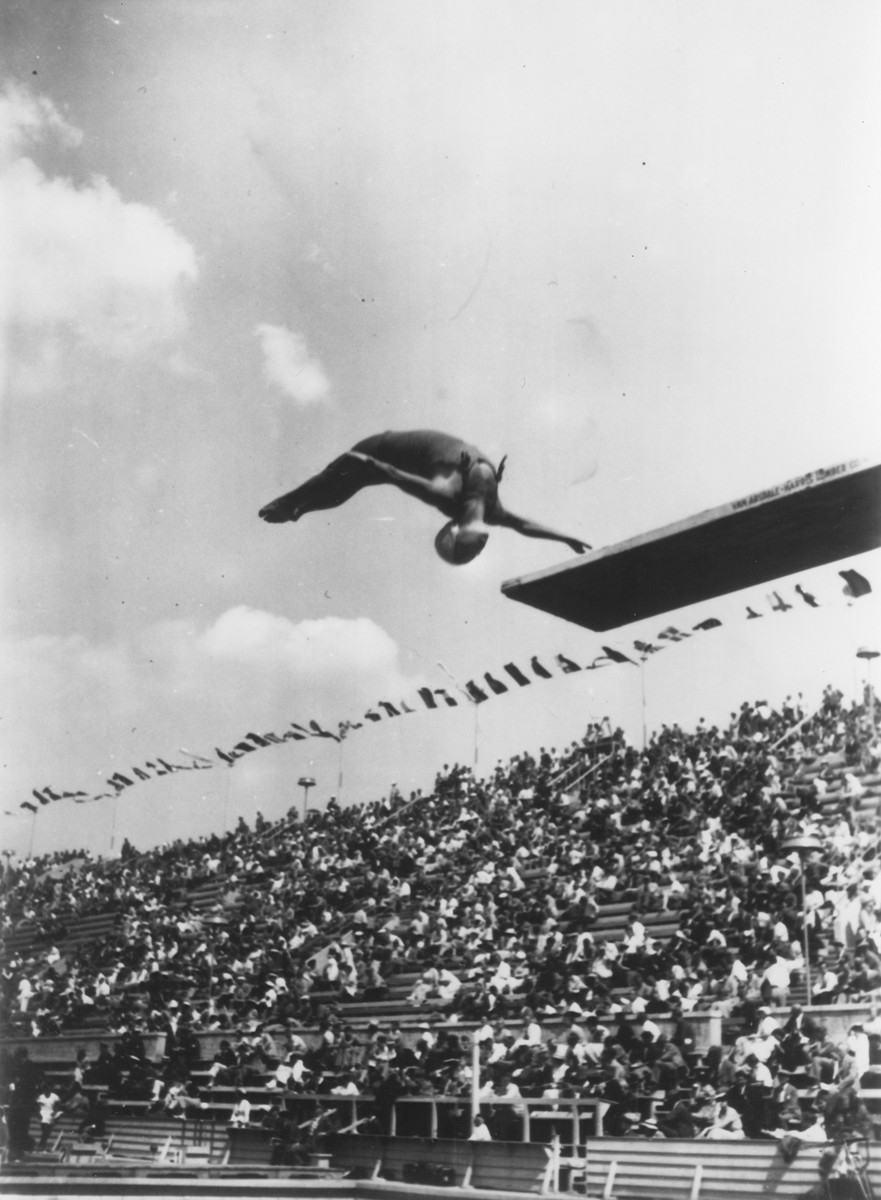 A woman competes in the diving competition at the 11th Summer Olympic Games.