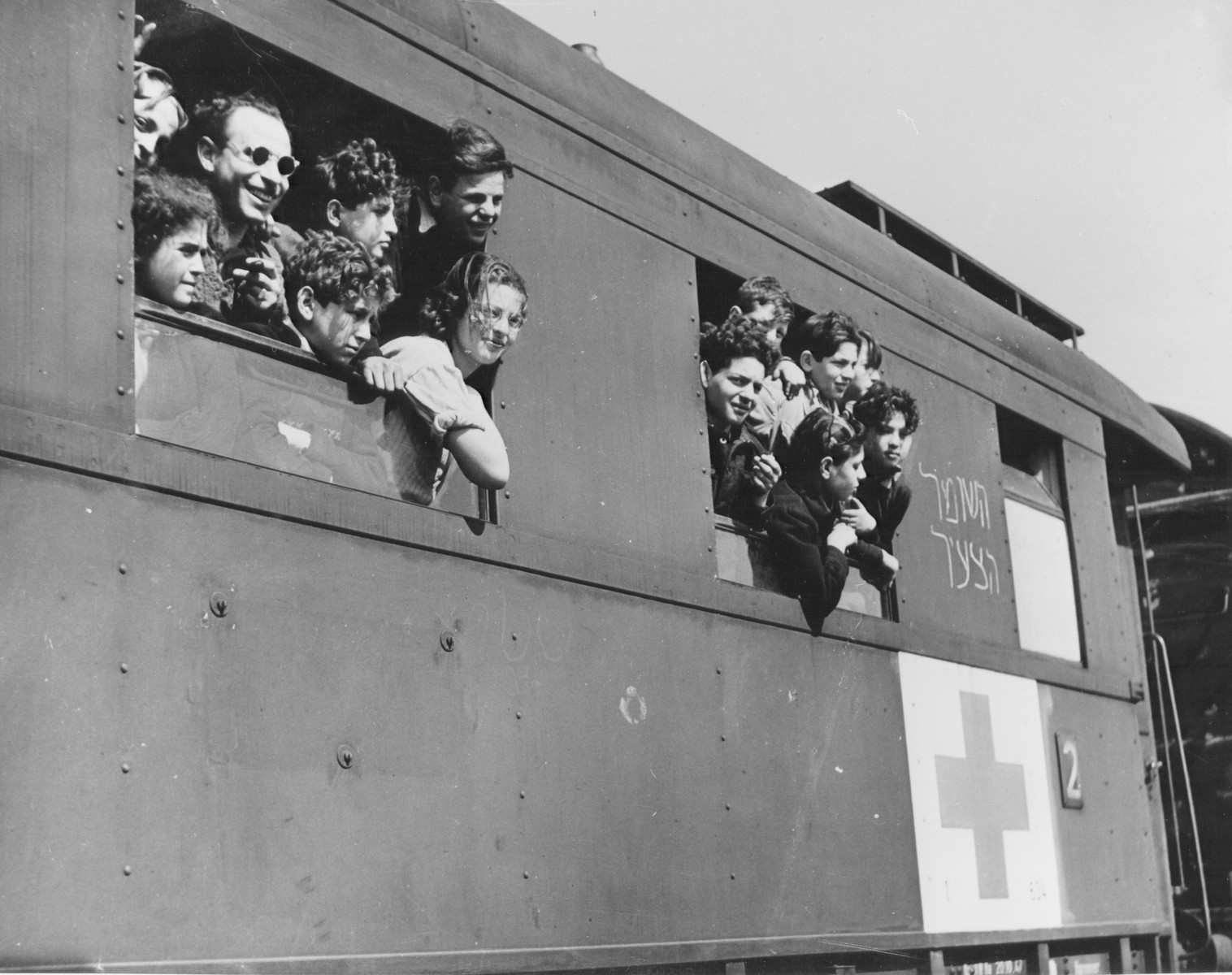 German Jewish orphans look out the windows of a Red Cross train while in Marseilles en route from the British Zone of Germany to Palestine.
