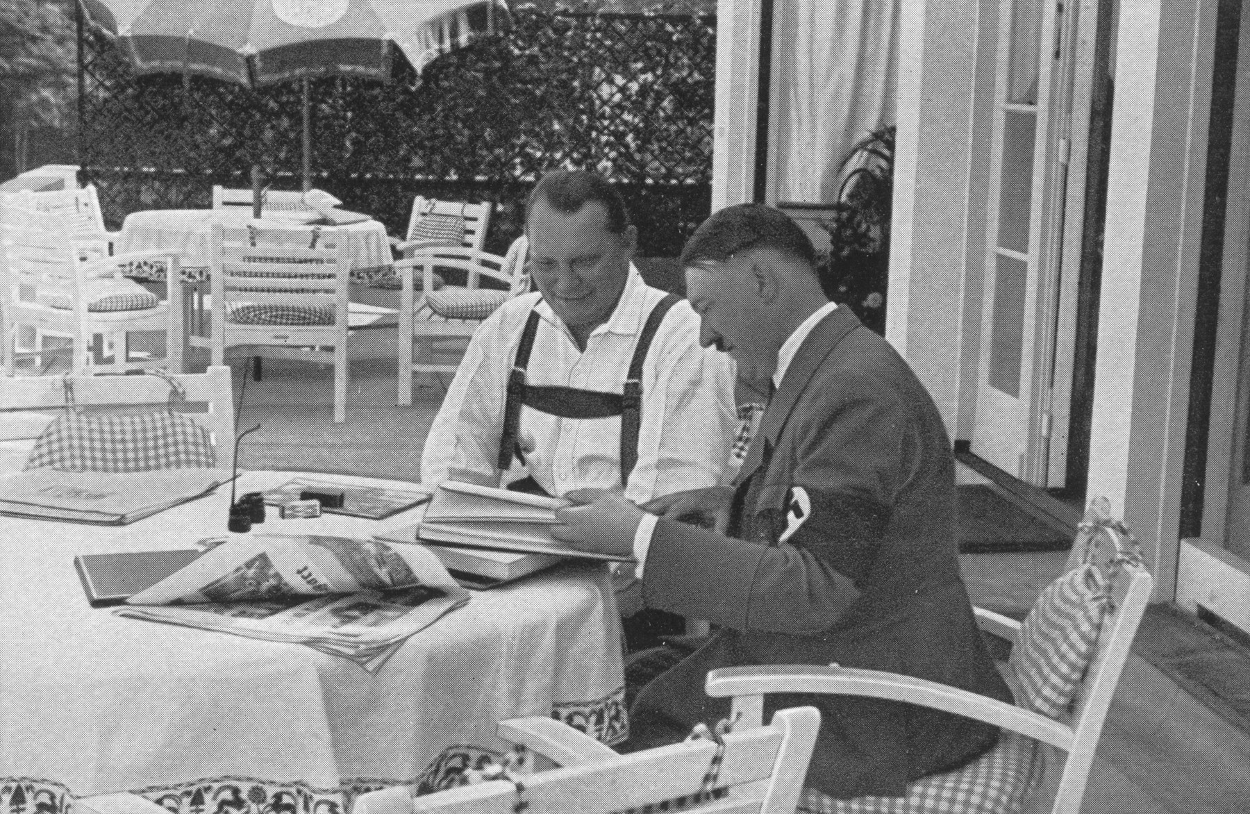Minister-president Hermann Goering meets with Adolf Hitler on a terrace in the Obersalzberg.