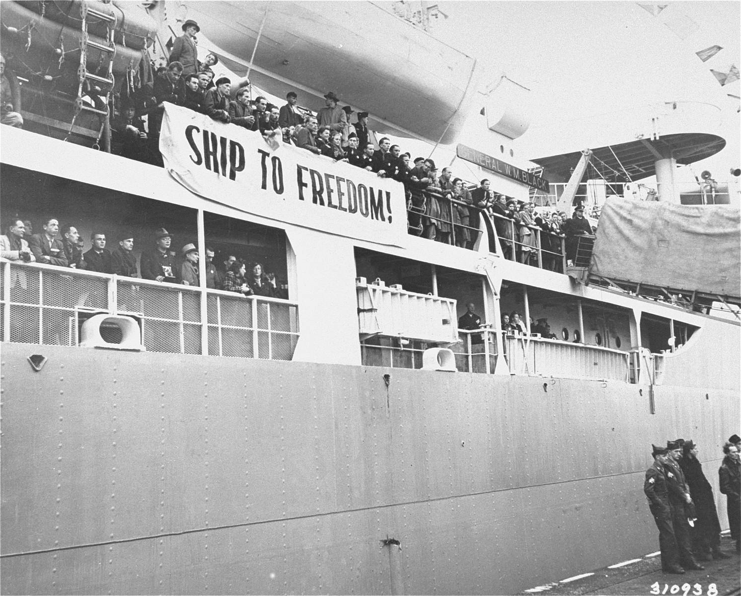Displaced persons of various nationalities seeking to immigrate to the U.S. line the decks of the General Black as it leaves the port of Bremerhaven.