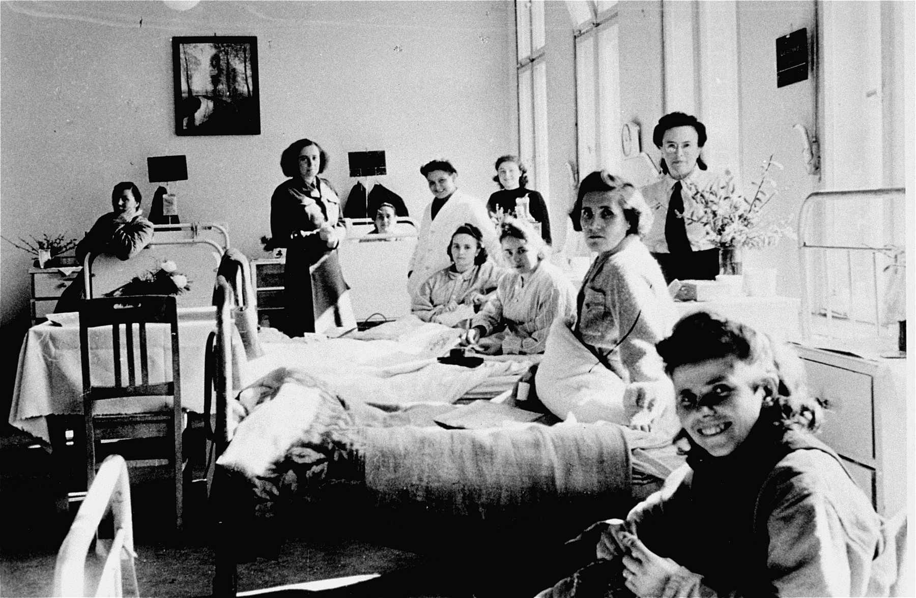 Women's ward of the hospital at the Bergen-Belsen DP camp.  The woman in the fourth bed from the right is Erzsabet Felberman Steiner. Both she and her sister Klara (originally from Gemzse, Hungary) survived Bergen-Belsen and remained there until they immigrated to Canada.   Pictured in the first bed in the front is is Franka Ptasznik Gertel from Lodz. She and her older sister were the only family members to survive the Auschwitz selection.
