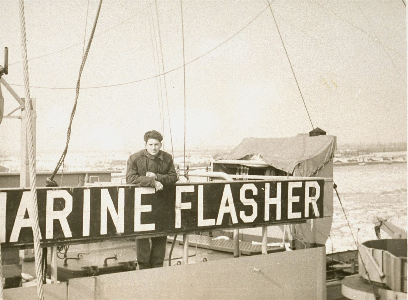 Manius Notowicz poses on the deck of the Marine Flasher just before its departure from the port of Bremerhaven.