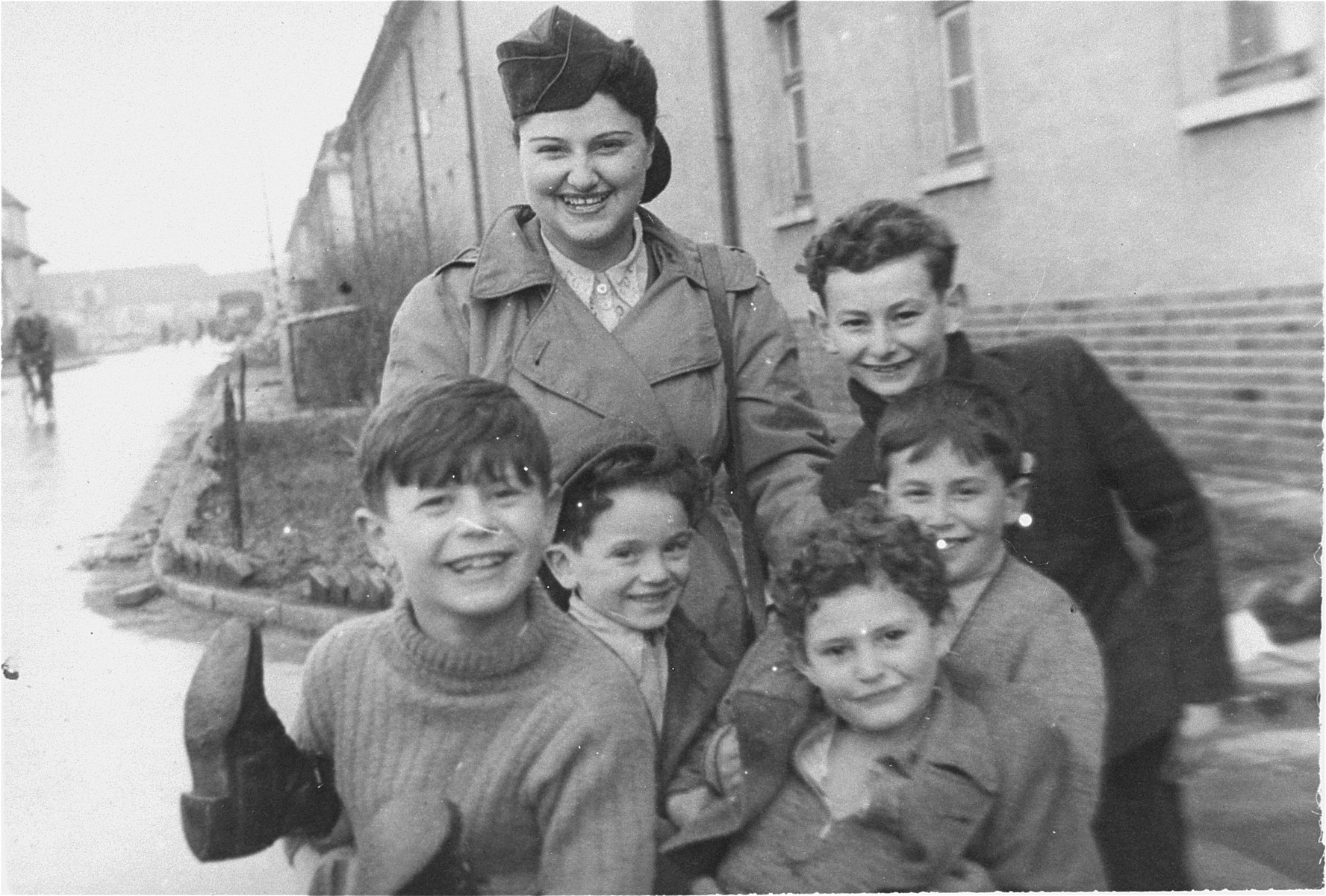 JDC relief worker Sally Wideroff poses with a group of orphaned children at the Bergen-Belsen displaced persons camp.    The photograph was given to Hadassah Rosensaft by Sally Bendremer.  The English caption on the back reads: 'To Hadasa, with fond remembrances, and best wishes for an early, safe and tremendous aliyah.  Sally von Joint.'