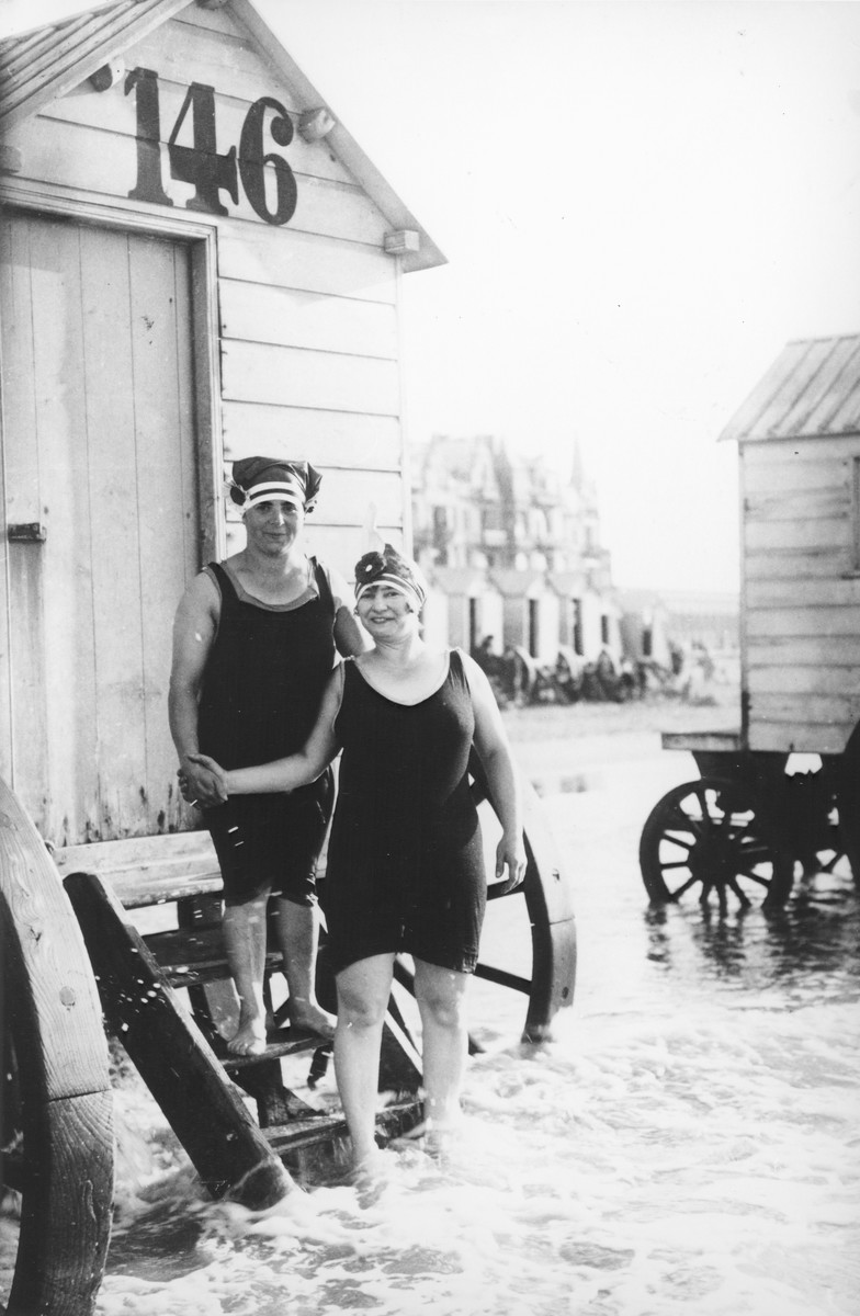 Two Belgian-Jewish women stand on the steps of a seaside cabana in Ostend.  Pictured are Ryfka Horowitz Halter (left) and a friend.