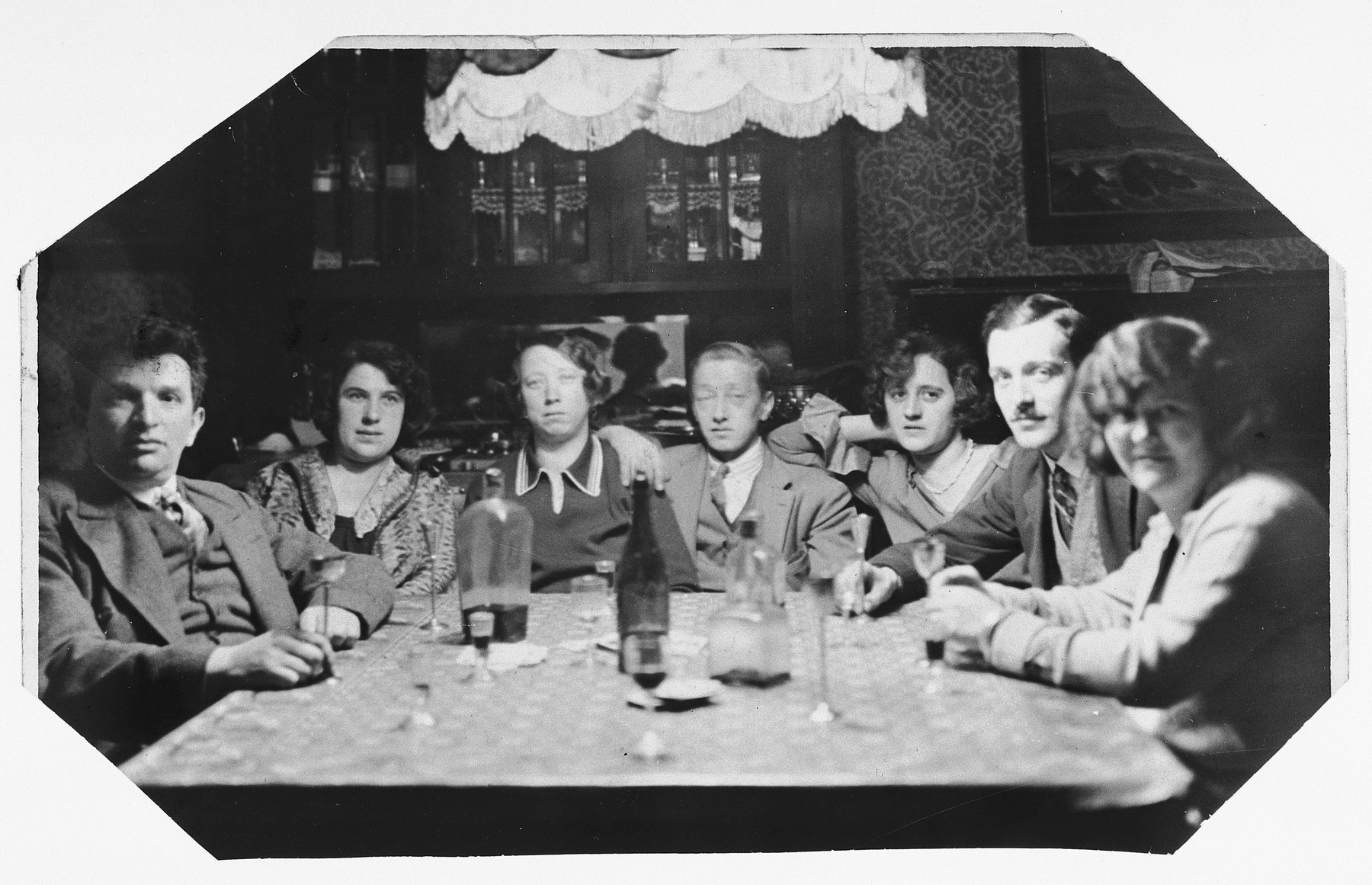 Rudolf and Ana Brosan (left) have a glass of wine with friends.