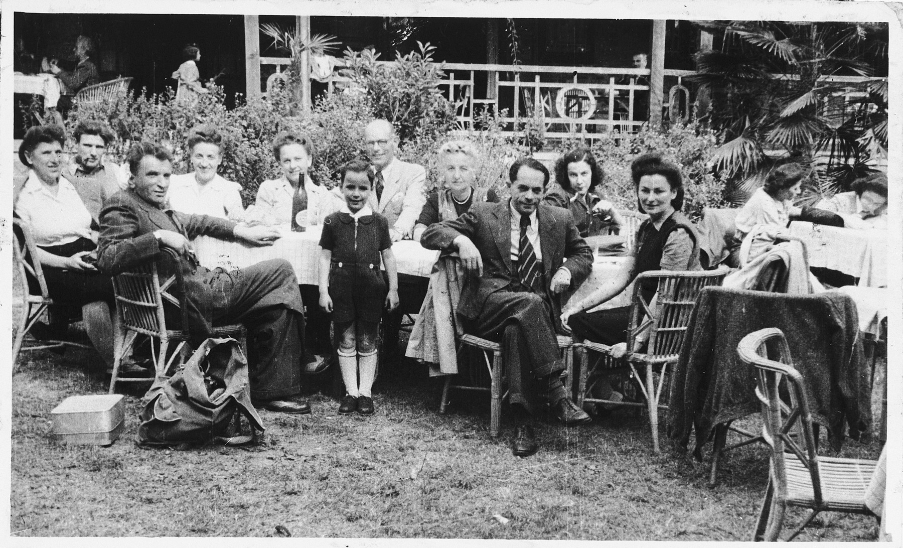 Jewish refugees socialize in a garden in Shanghai.  Among those pictured are Ana, Alfred and Rudolf Brosan (at the left) and Richard Brosan (second from the right).