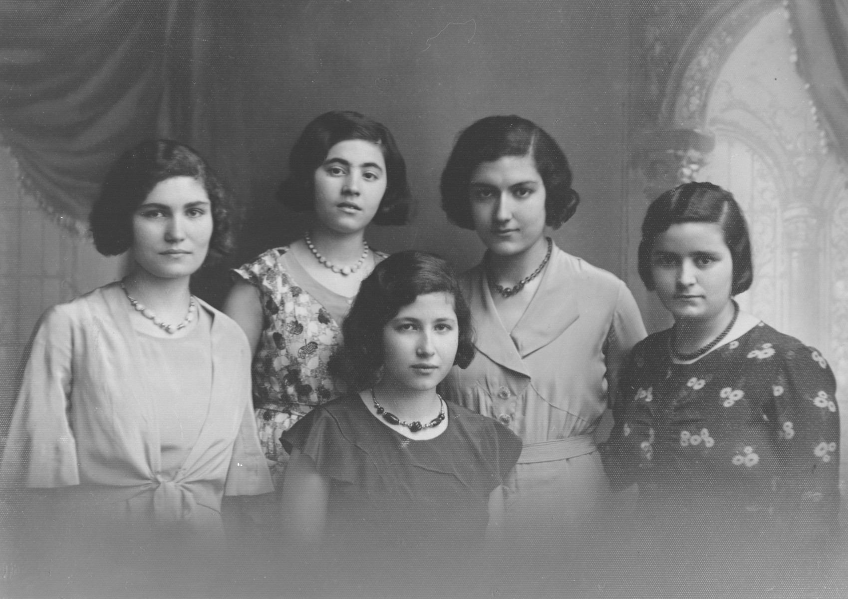 Portrait of five young Albanian women.  Pictured are three sisters and two cousins: Jeannette Matathia (later Levis), Henriette Matathia (later Levis), Fortune Jacoel (perished in Auschwitz), Mathile Matathia (later Sebetai) and Anna Levis (later Osmos).
