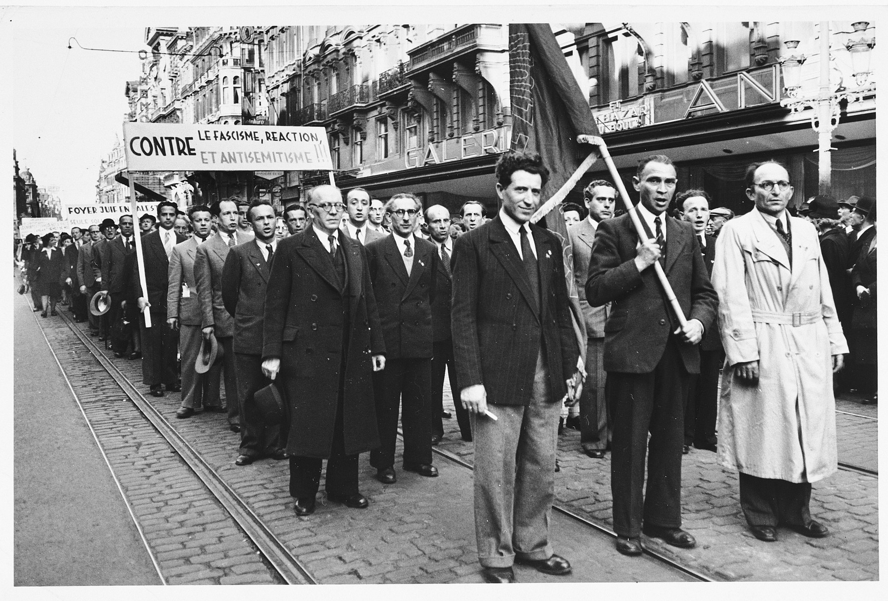 "Belgian Jews march in a postwar pro-Zionist demonstration in Belgium.  The banner reads ""Against, Fascism, Reaction and Antisemitism."""