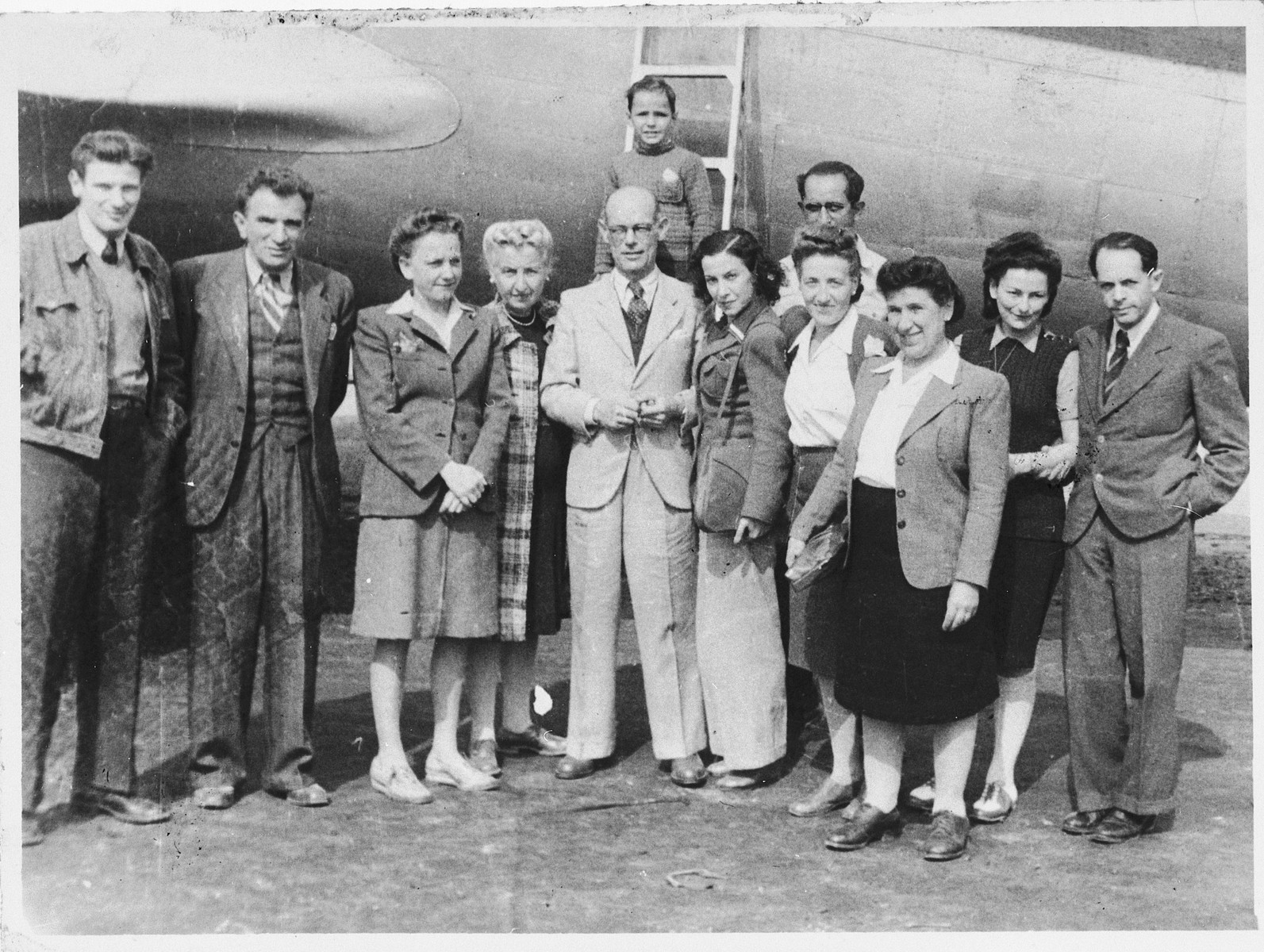Group portrait of Jewish refugees at the Shanghai airport.  Among those pictured are Alfred Brosan (far left), Rudolf Brosan (second from the left), Anna Brosan (third from the right in the foreground), and Richard Brosan (far right).