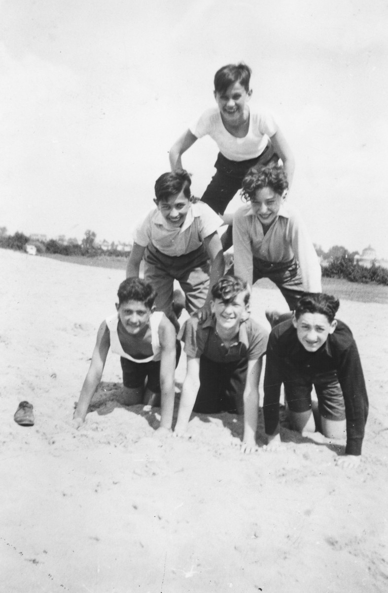 Jewish boys from Lodz form a human pyramid at a summer camp.  Among those pictured is Henry Choroszcz (husband of the donor).