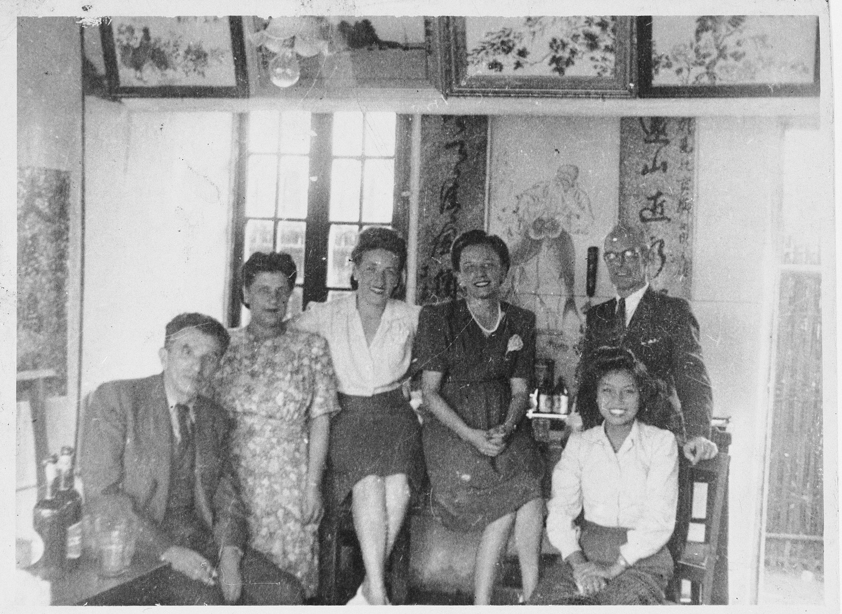 Group portrait of Jewish refugees and a Chinese woman inside a home in Shanghai.  Pictured on the left are Rudolf and Ana Brosan.