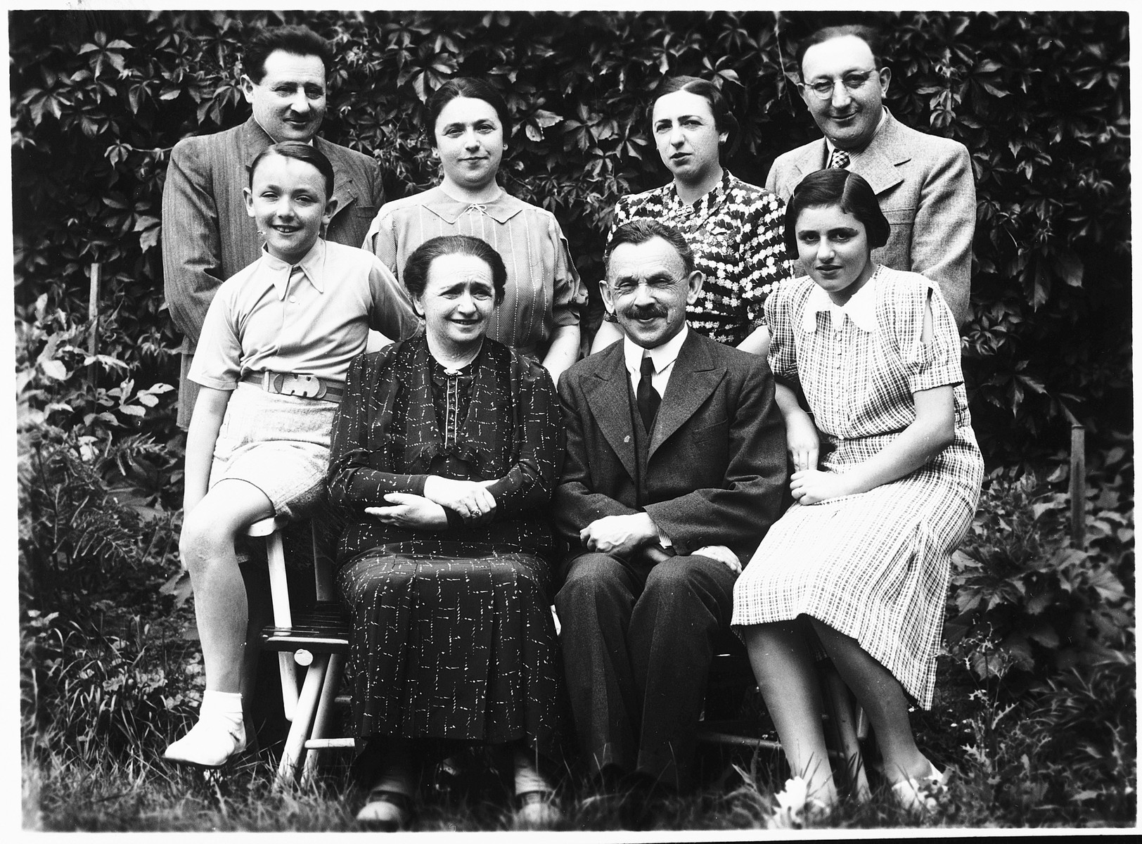 Group portrait of an extended Jewish family posing outside in a town in Bohemia.  Pictured sitting from left to right are: Ivo Reiter, Berta Budlovska, Zigmund Budlovsky and Helena Hallerova. Standing are: Oskar Haller, Sephanka Hallerova, Augusta Reiterovska and Otto Reiter.