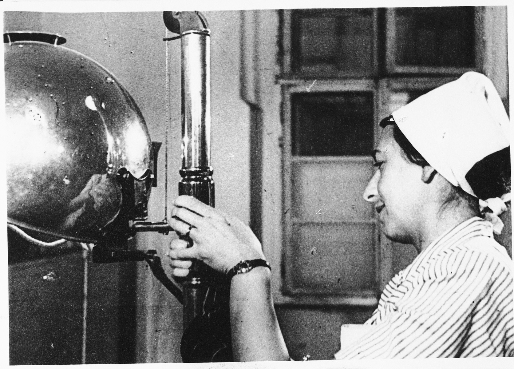 A Jewish female prisoner works as a nurse in a clinic in the Hamburger caserne in Theresienstadt.  The photograph was taken in connection with the Red Cross visit to Theresienstadt.  Pictured is Augusta Reiterova, the aunt of Helena Hallerova Bisicka.  Augusta perished shortly after this photograph was taken.