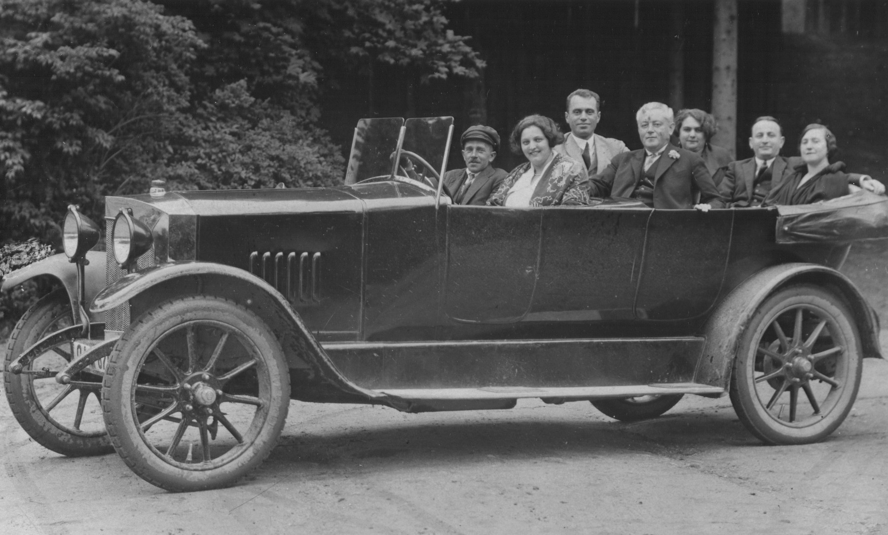Hungarian Jews on vacation drive in an open automobile while vacationing in Marienbad.  Marci (Marton) Vecsey (uncle of the donor) is pictured in the center.
