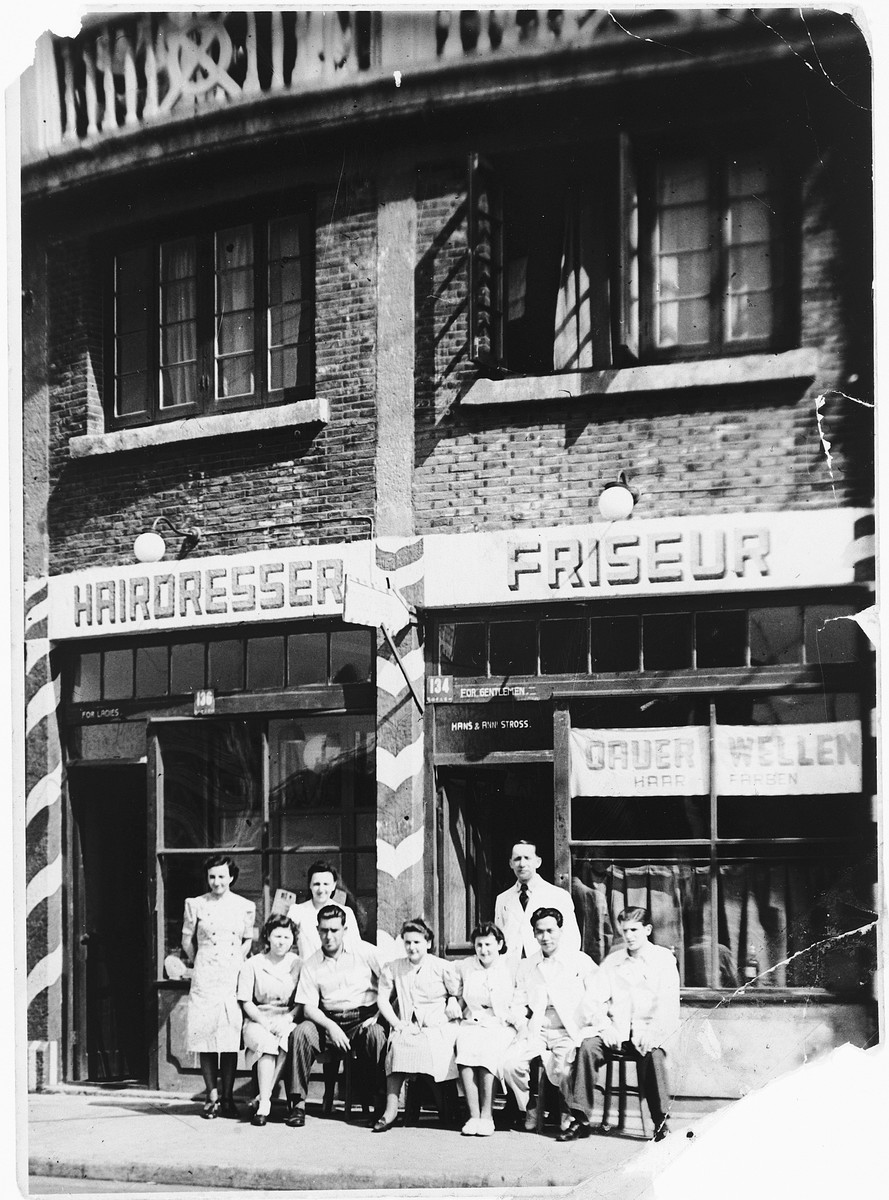 Students and teachers pose outside a hairdressing school in Shanghai.  Among those pictured is Alfred Brosan (front row, second from the left).