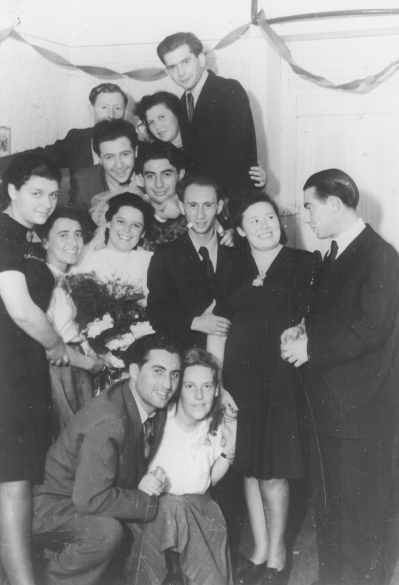 Esther Berner and Lolek Segal celebrate their wedding in the Zeilsheim displaced persons' camp.  Also in attendance are Bela Jakubowicz and Henryk Choroszcz.