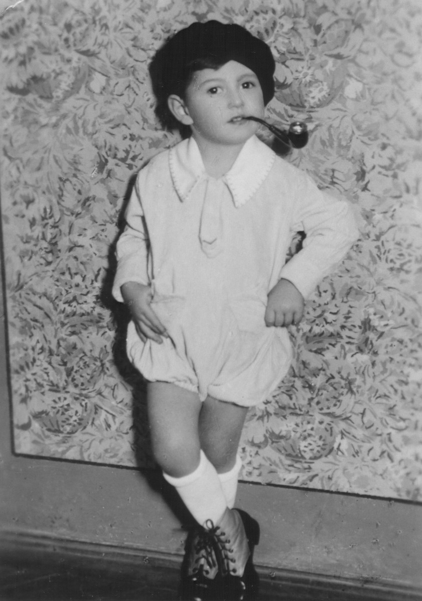 Six-year-old Janos Koenig poses with a pipe.