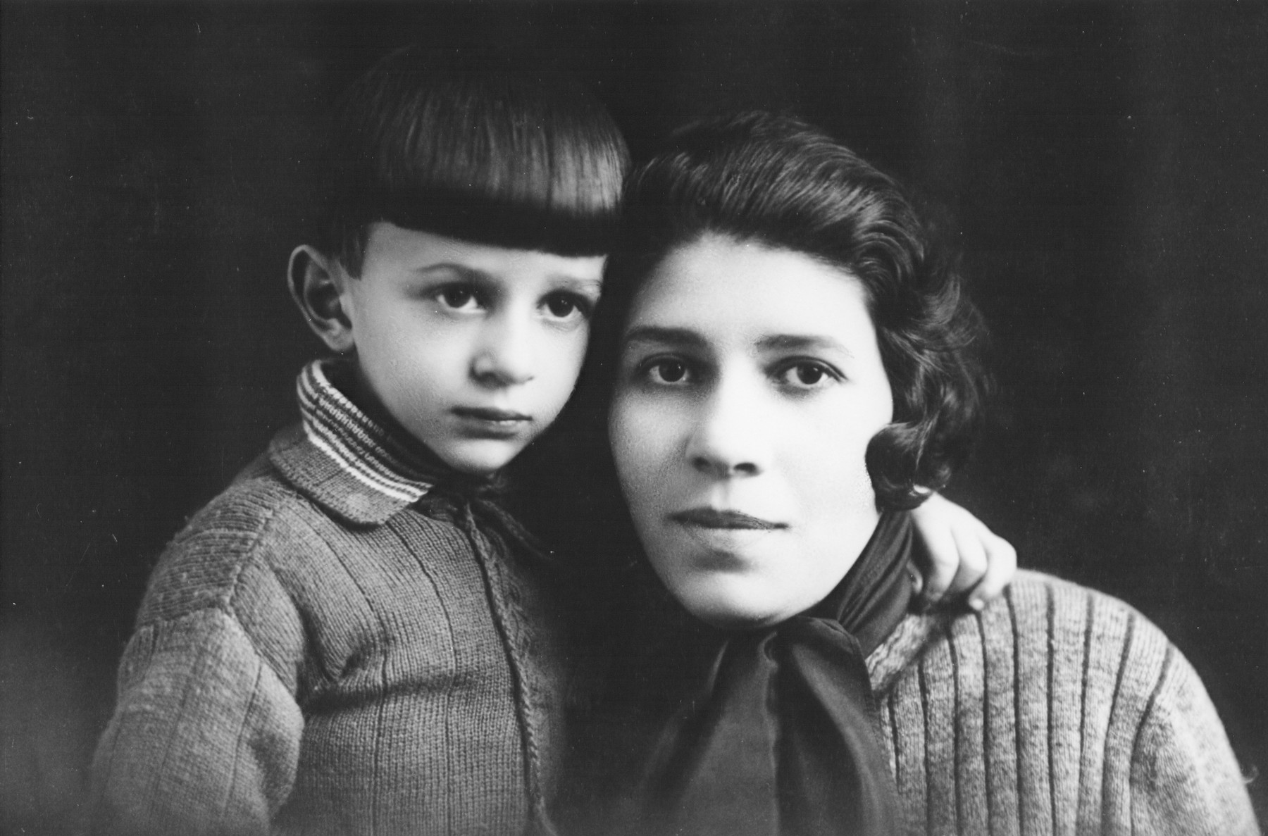 Studio portrait of a mother and child.  The mother is the sister of Joseph Halter.