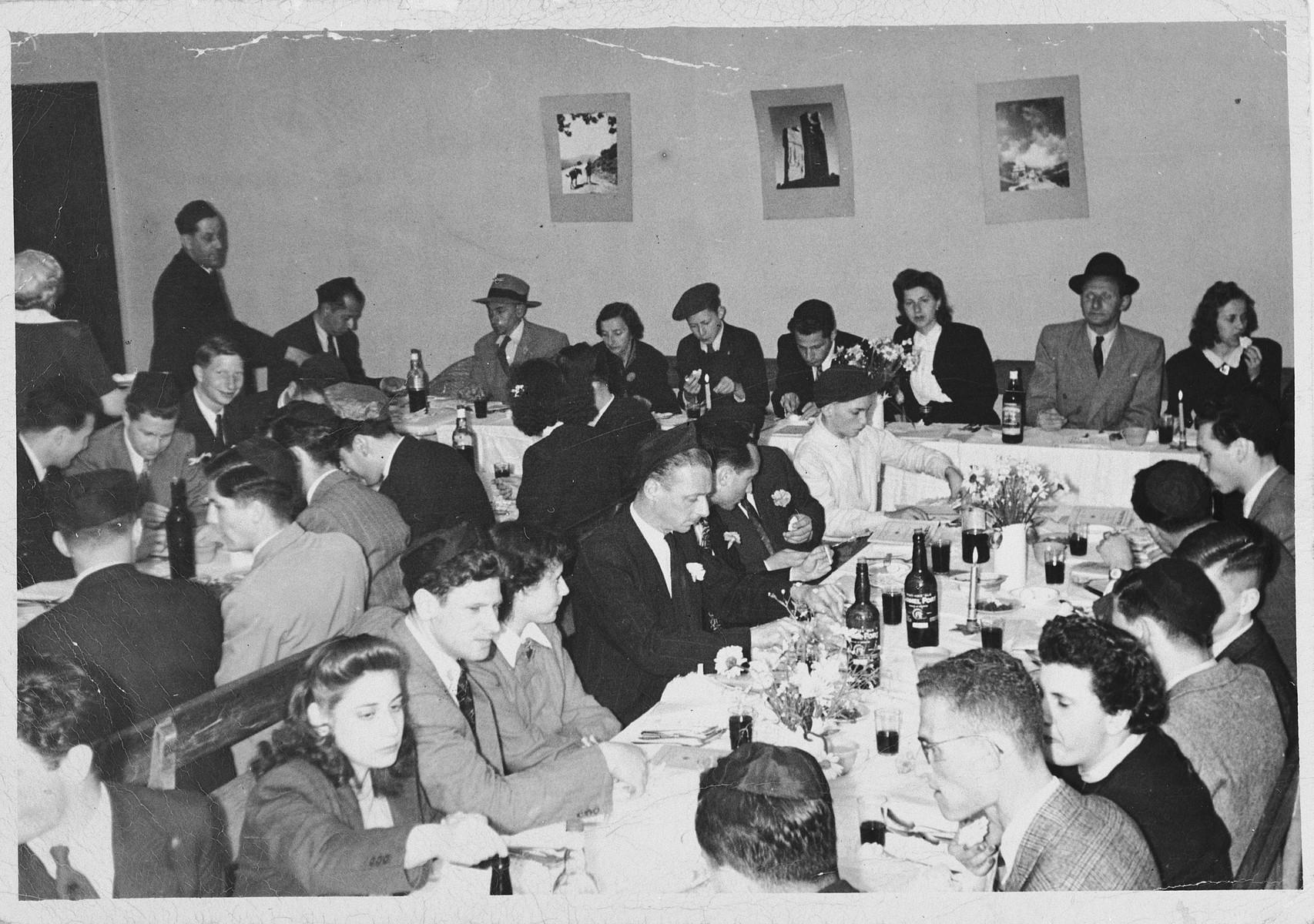 Jewish refugees attend a communal seder in Shanghai.  Alfred Brosan is pictured third from the left in the center row.