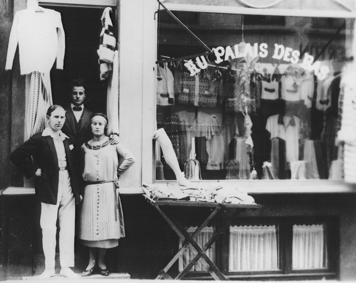 Three Belgian Jews stand outside their clothing store in Ostend.  Pictured are the Mahler family.