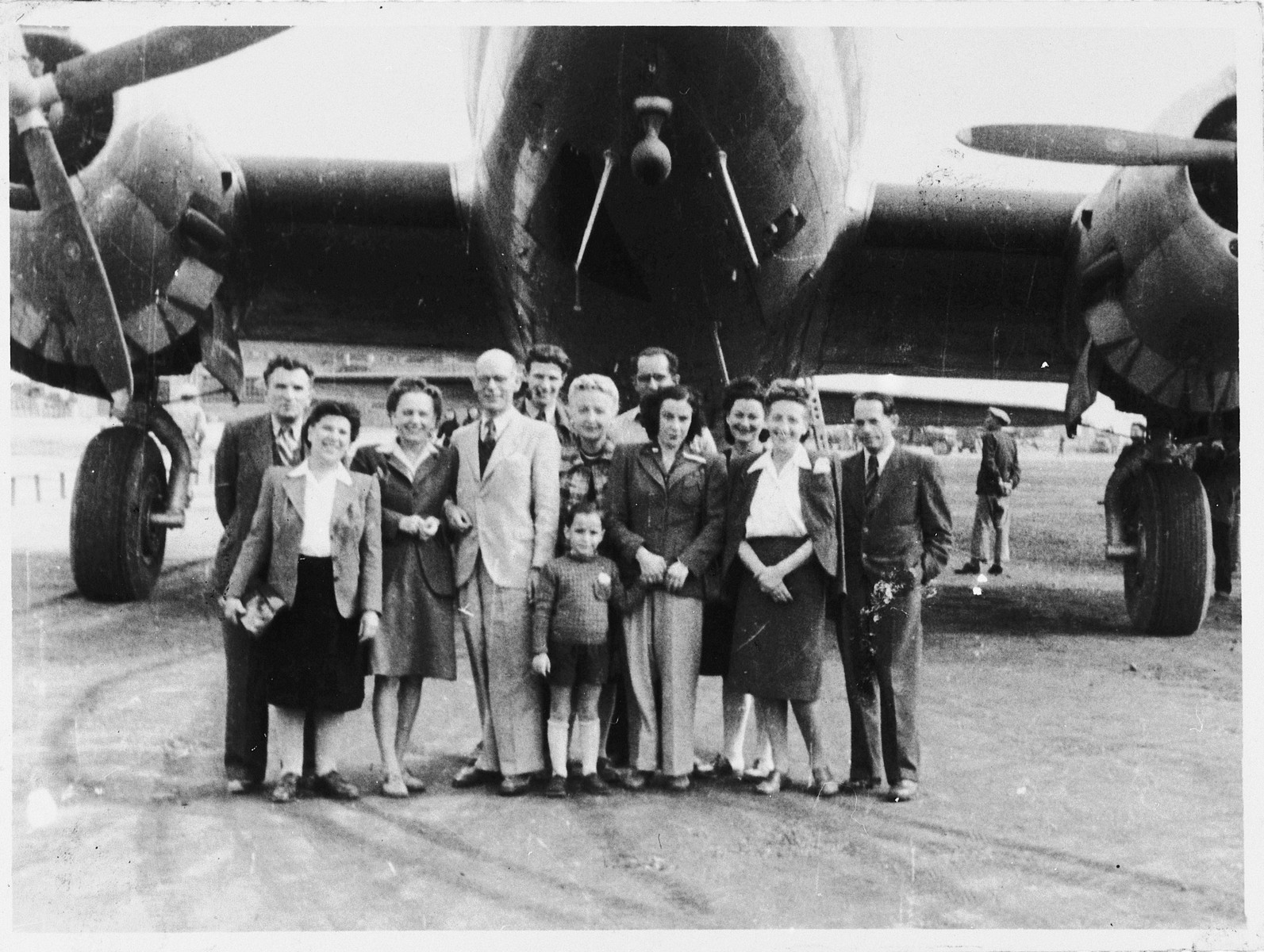 Group portrait of Jewish refugees at the Shanghai airport.  Among those pictured are: Rudolph and Ana Brosan (at the far left), Alfred Brosan (center, behind the man in the light suit), and Richard Brosan (first on the right).