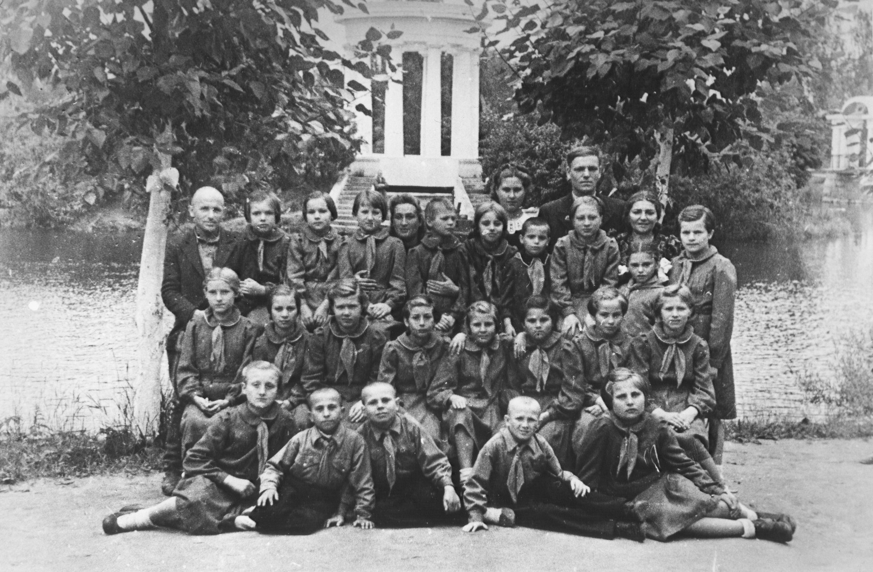 Polish children in an orphanage in the Soviet Union.  Standing on the top left, is the director, Marek Liwszyc, a Polish-Jewish refugee.